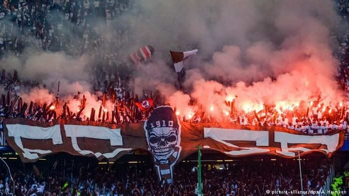 St. Pauli supporters light up the stands with flairs. Image courtesy of  St Pauli Supporter Merch .