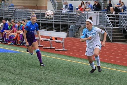Cascadian rivalries transcend leagues, as Vancouver Island FC's Rachel Baird (left) tries to a beat Seattle Sounders Women player to the ball. (Photo: League Website)