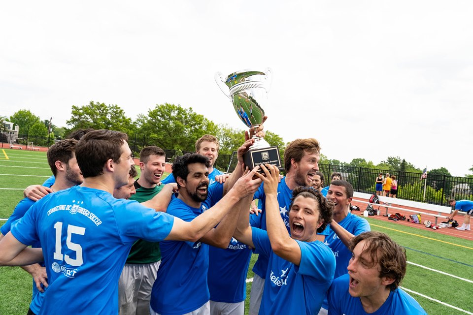 Federal City Wanderers celebrate their league championship.