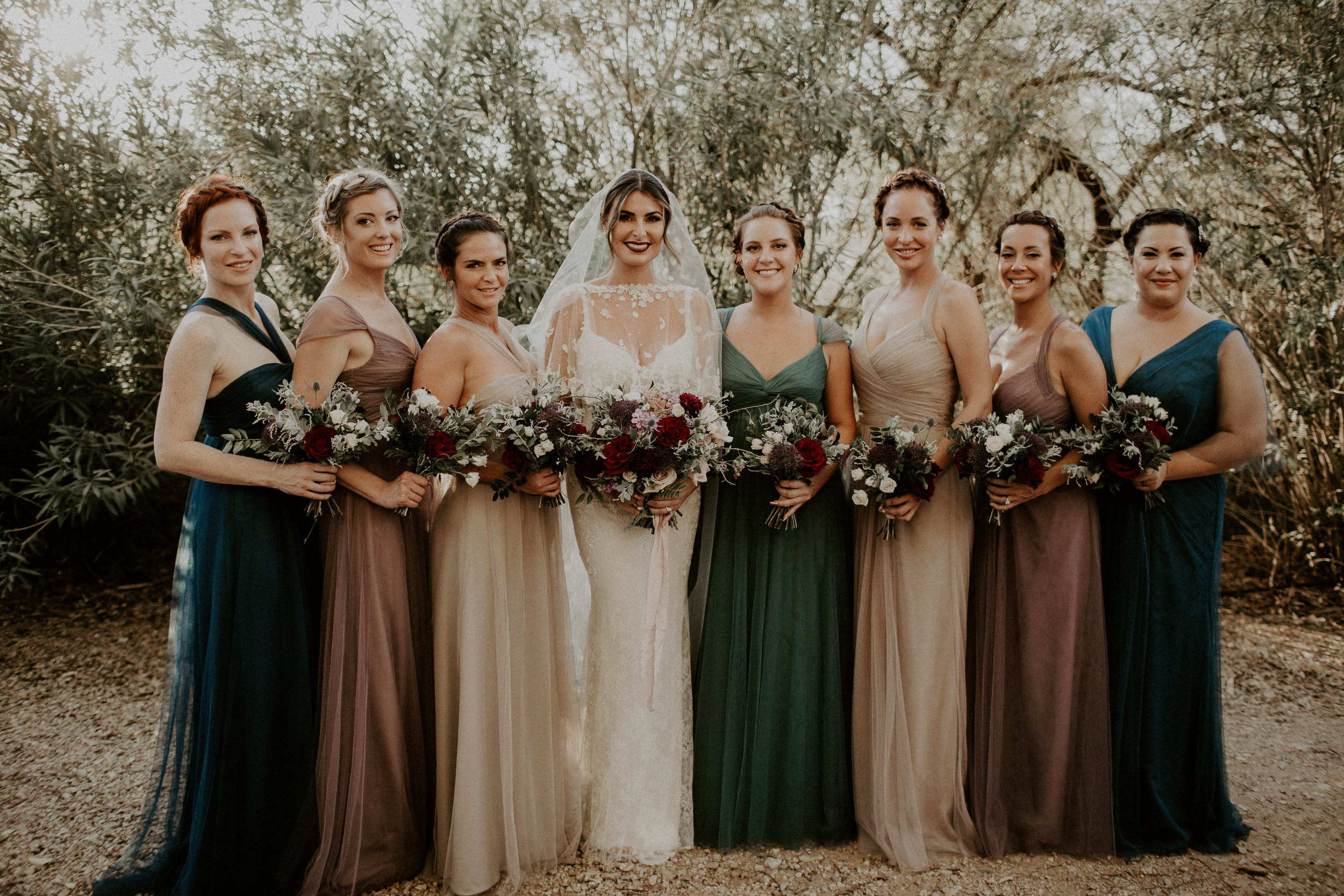 Moody Desert Wedding - Bridesmaids in Muted Toned Gowns