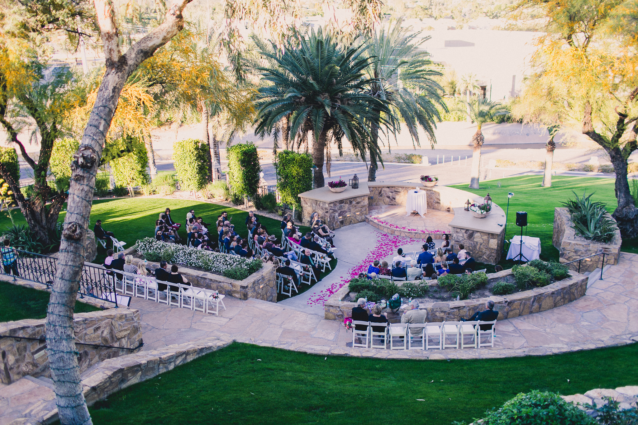 Colorful Springtime Wedding at Wrigley Mansion - Ceremony with Hot Pink Rose Petals on Aisle