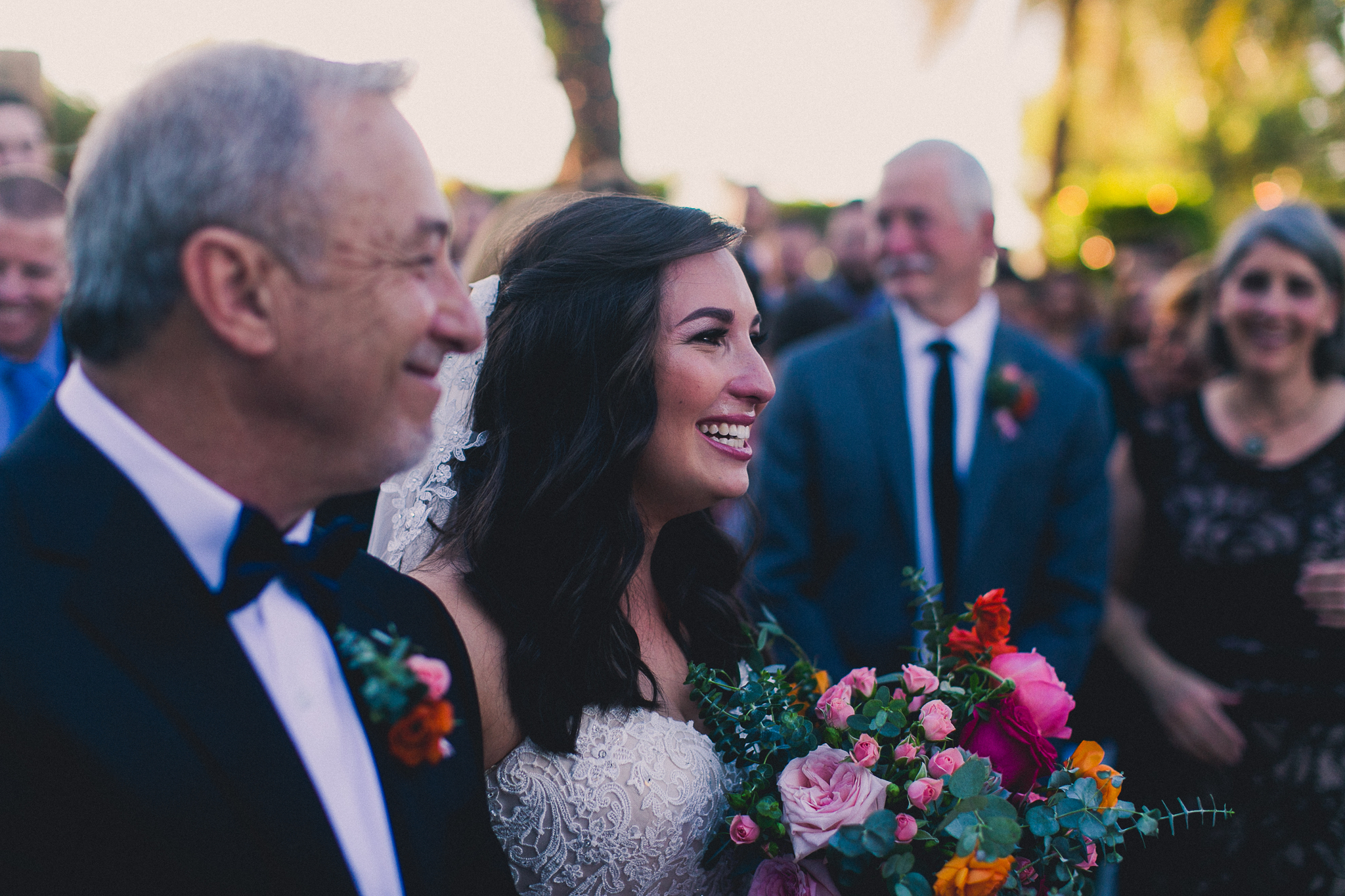 Colorful Springtime Wedding at Wrigley Mansion - Bride and her dad walking down the aisle