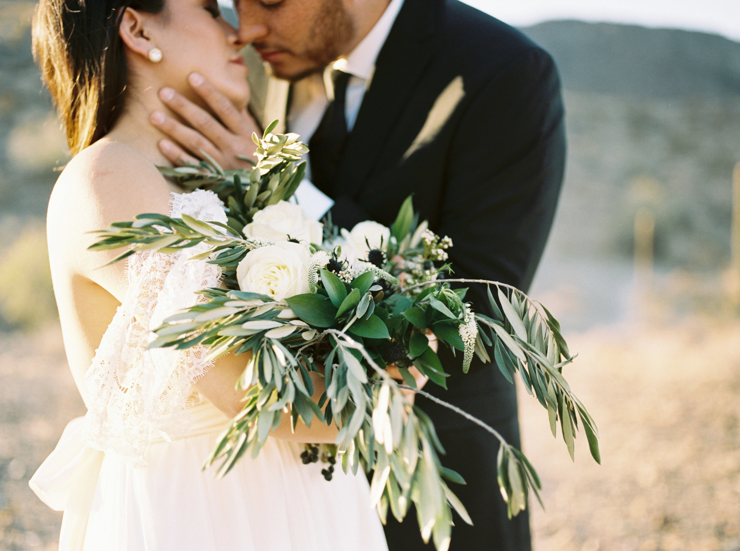 Fine Art Desert Elopement - Olive bouquet with white and black blooms