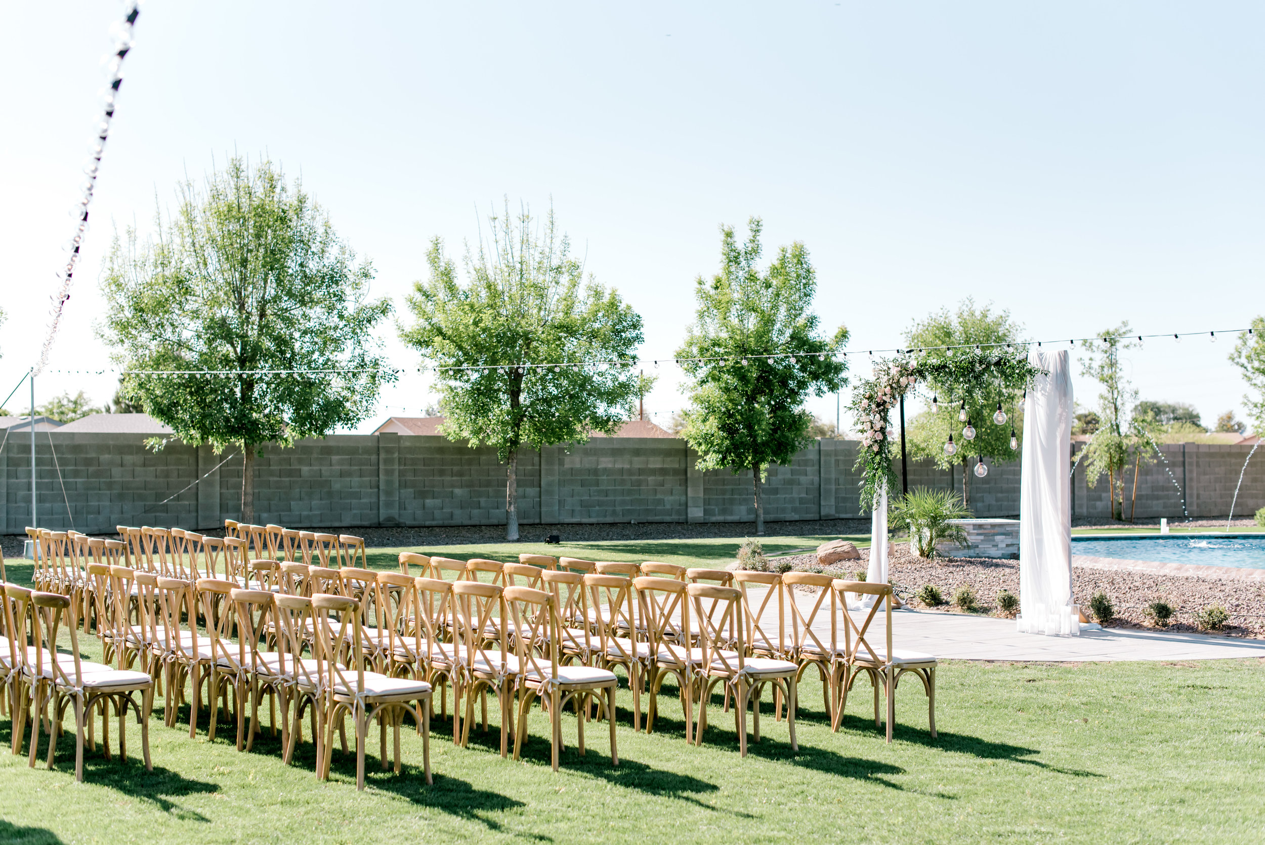 Blush and white backyard wedding ceremony