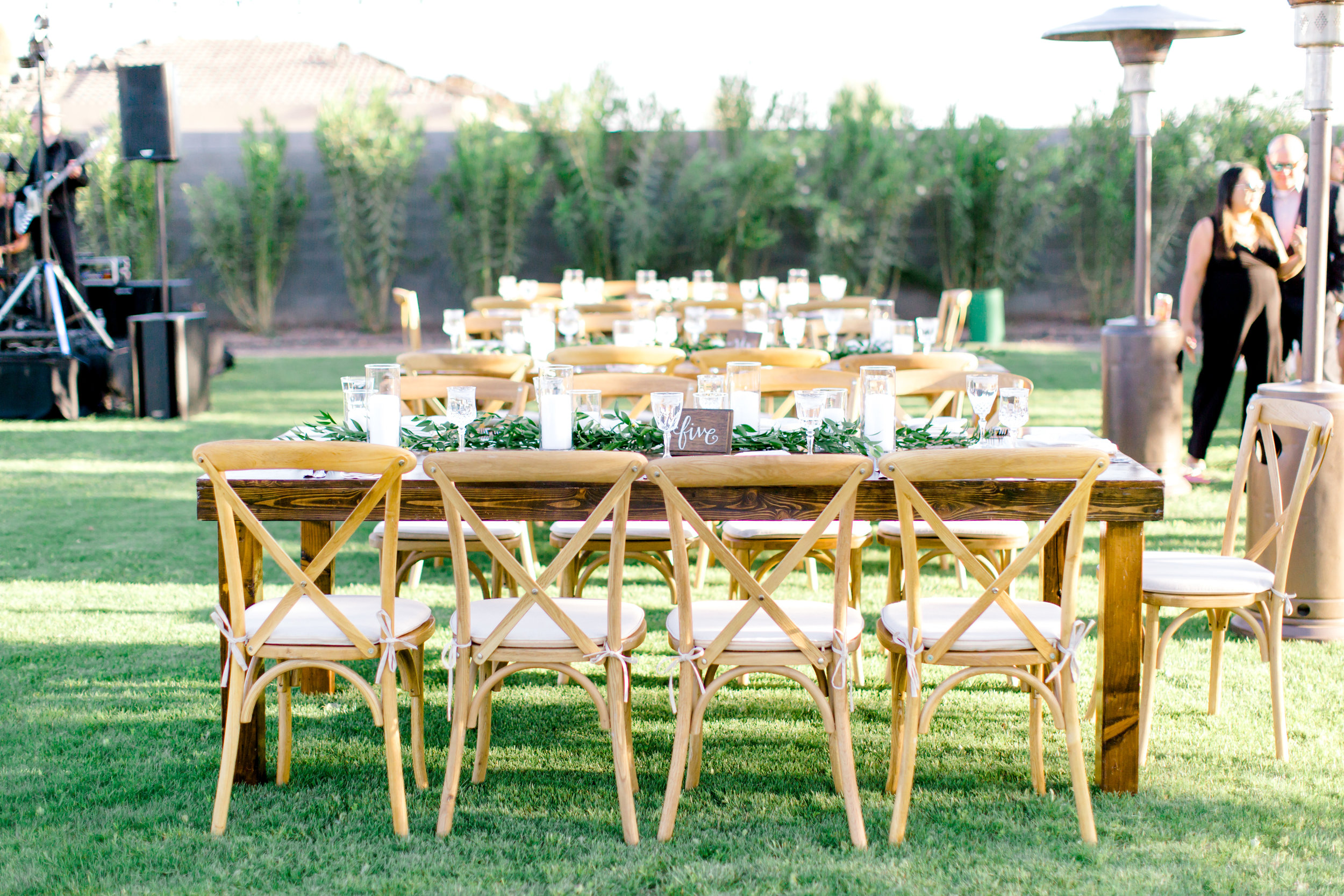 Blush and white backyard wedding - Farm Tables with Loose Greenery