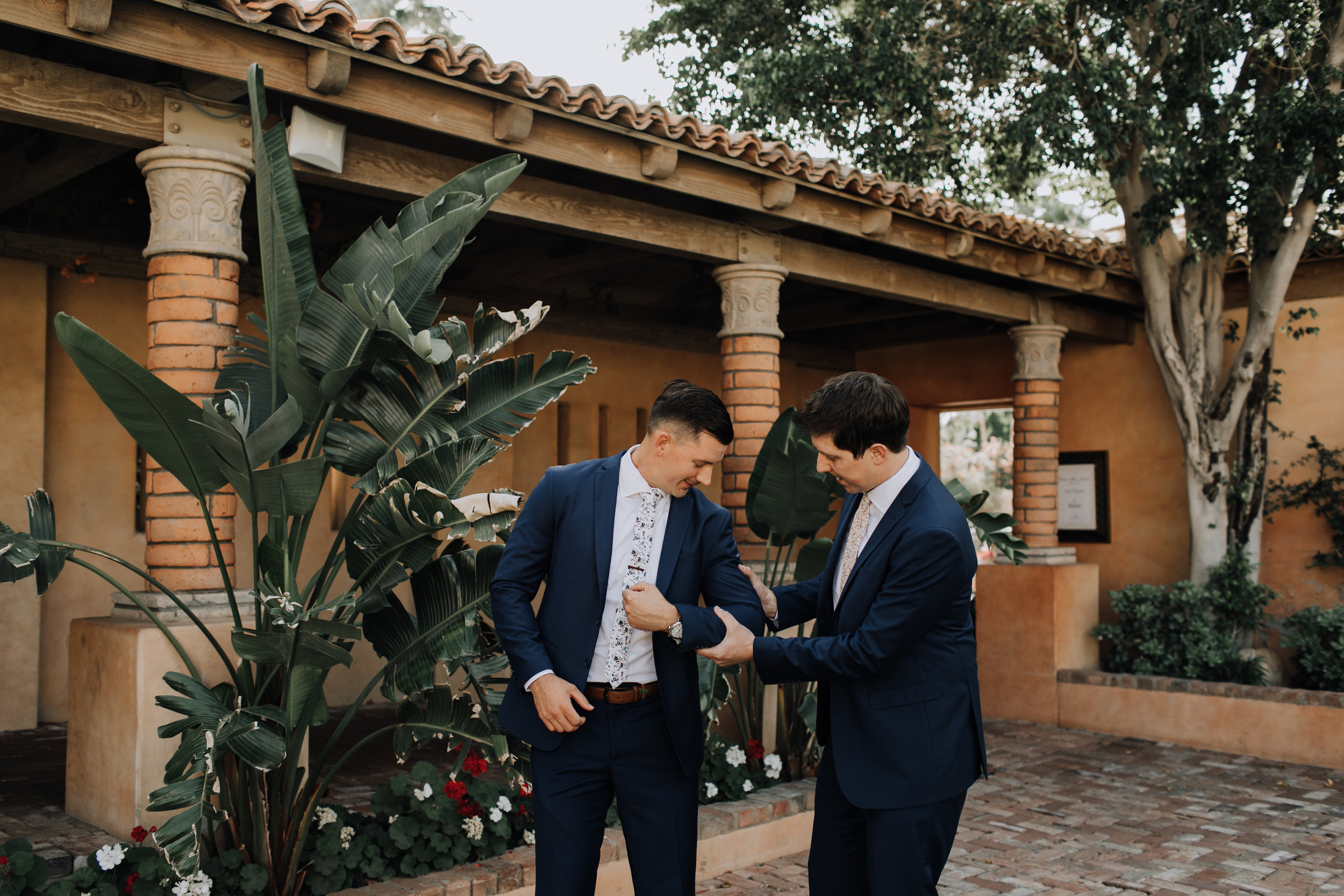 Groom and Groomsmen Style - Navy Suits with Floral Ties