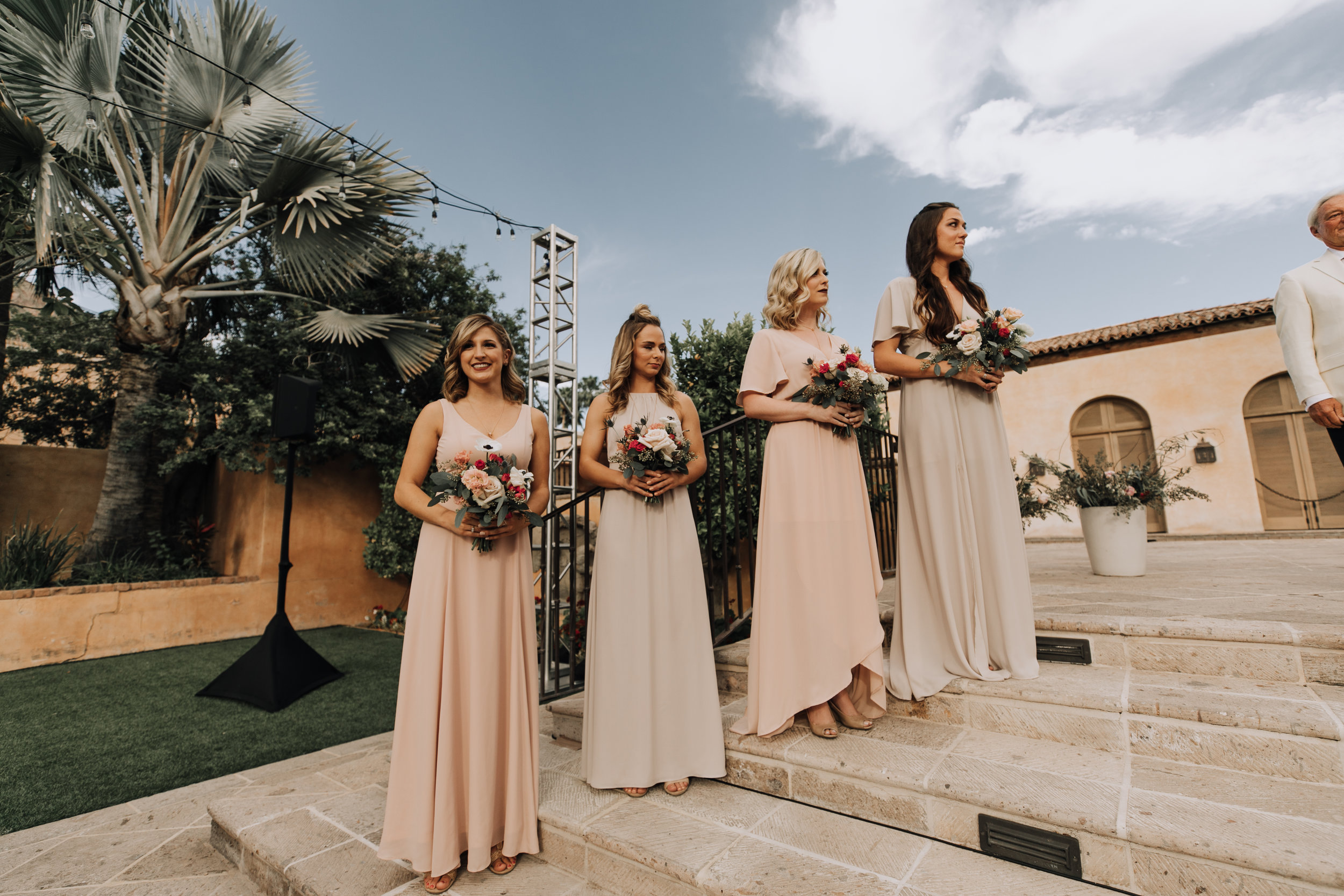 Bridal Party in Nude Gowns at ceremony