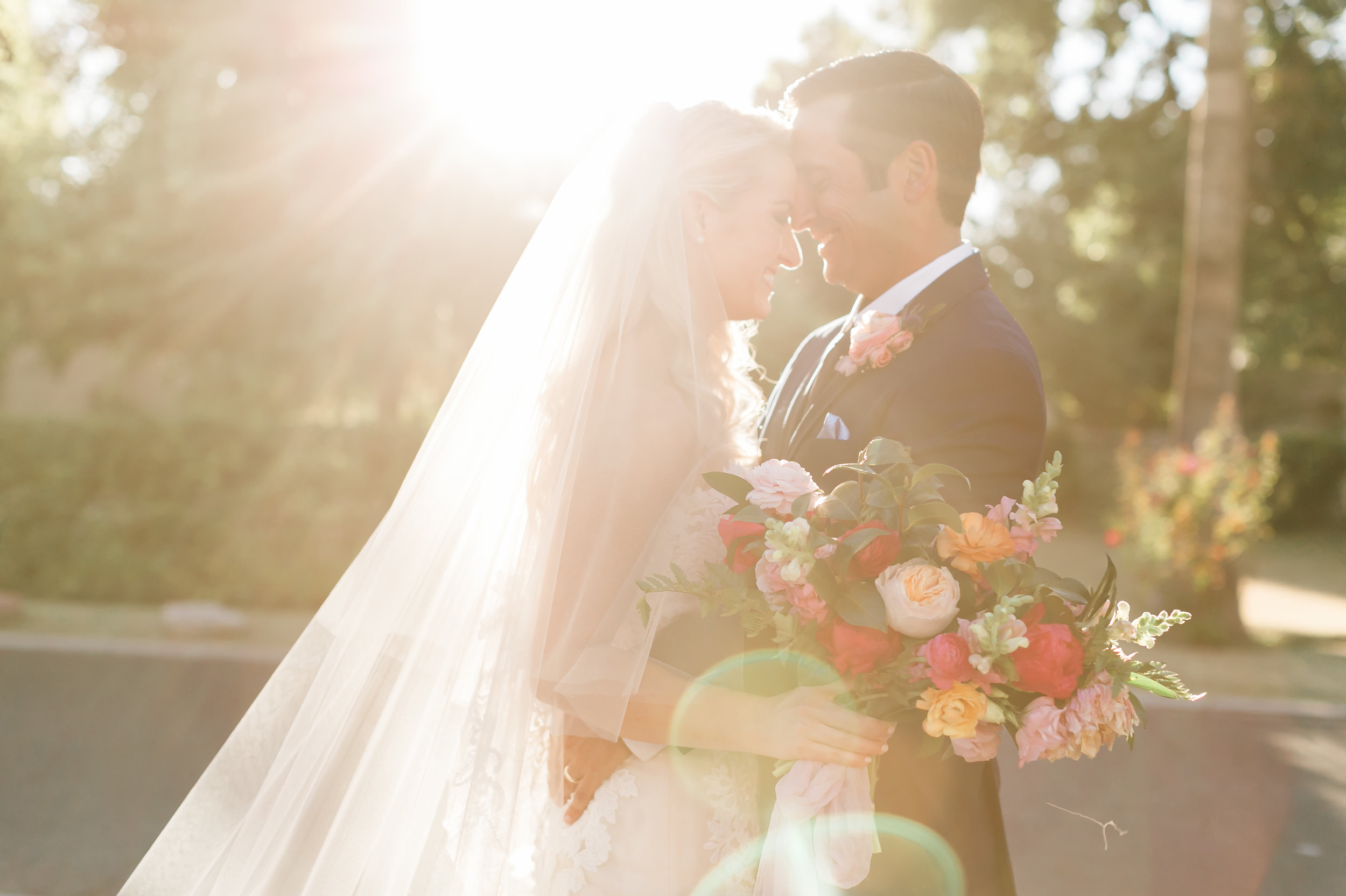 Private Estate Wedding in Phoenix - Bride and Groom with Magenta, Blush,  and peach bouquet