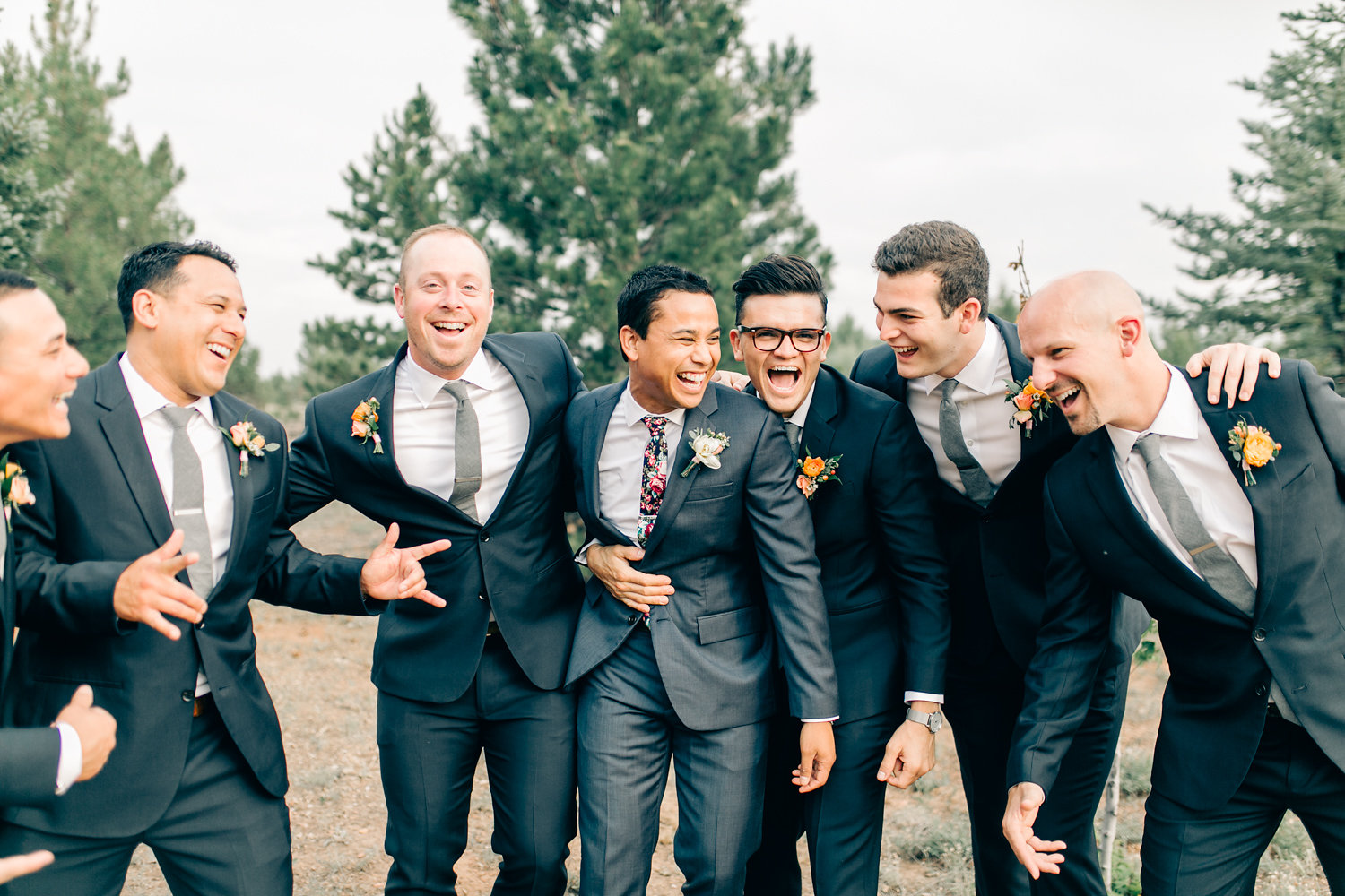 Colorful Cabin Wedding - Groomsmen with Orange Boutonnieres and Charcoal Suits