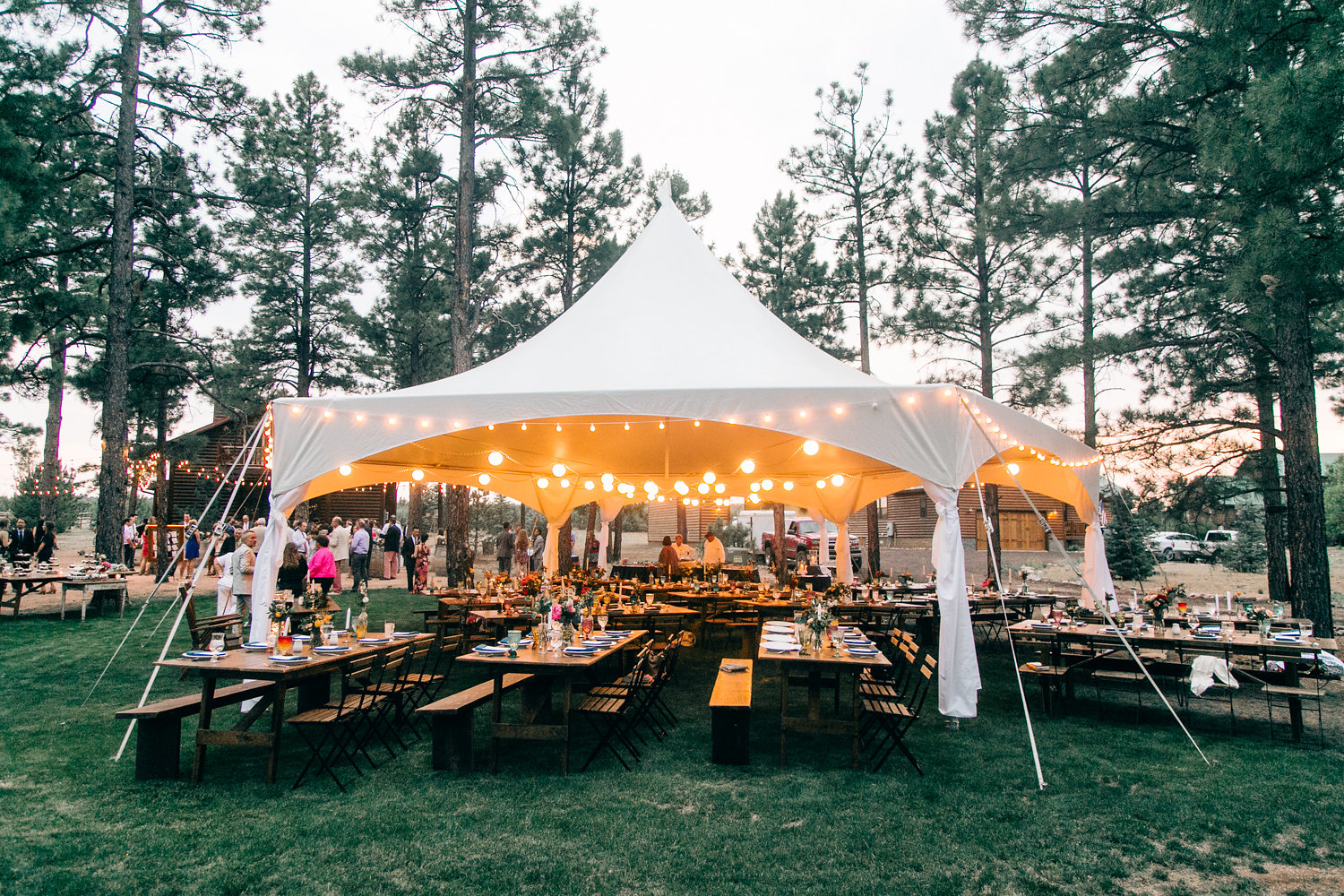 Colorful Cabin Wedding - Tent Reception with String Lights and Farm Tables