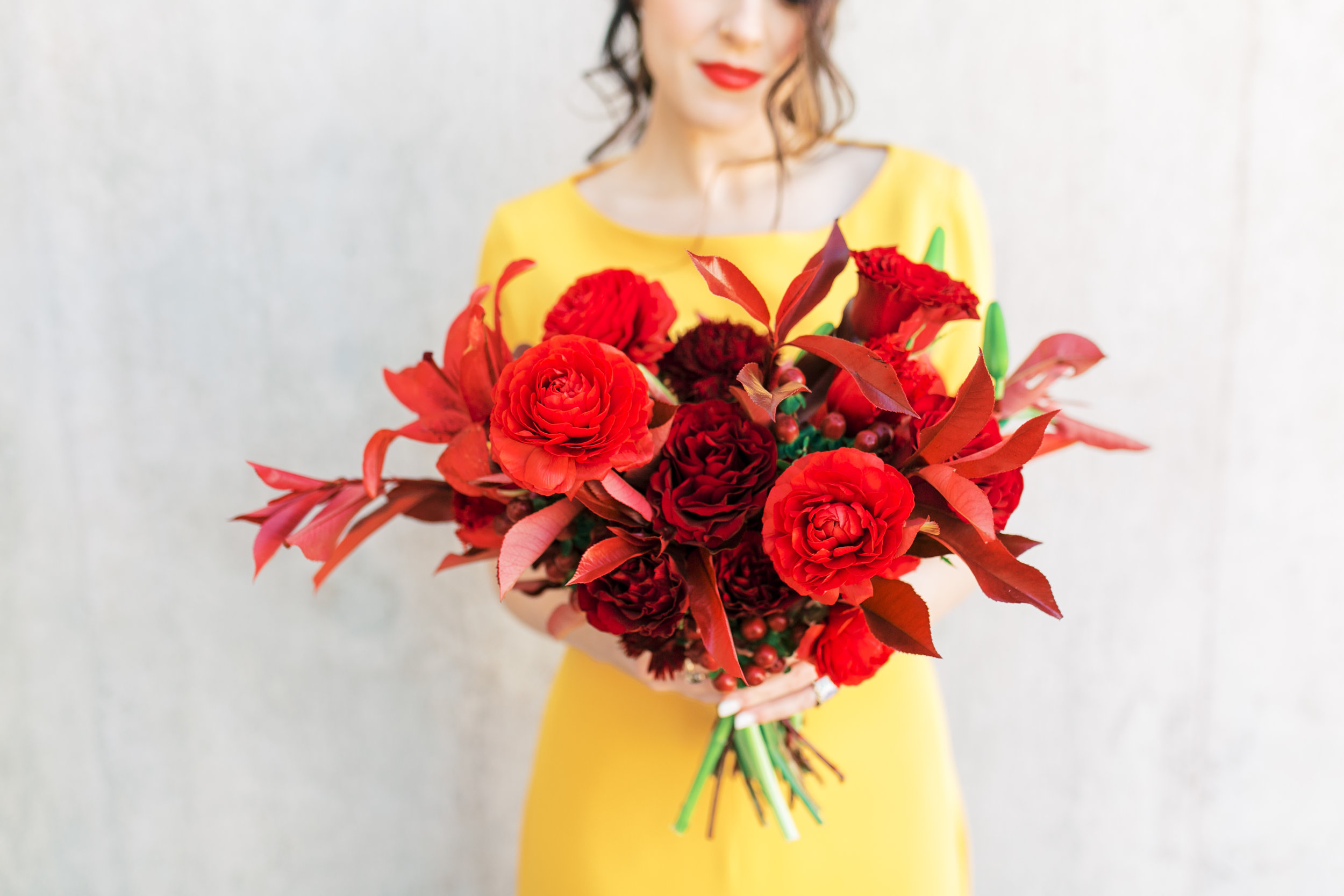red and yellow wedding inspiration - red bouquet