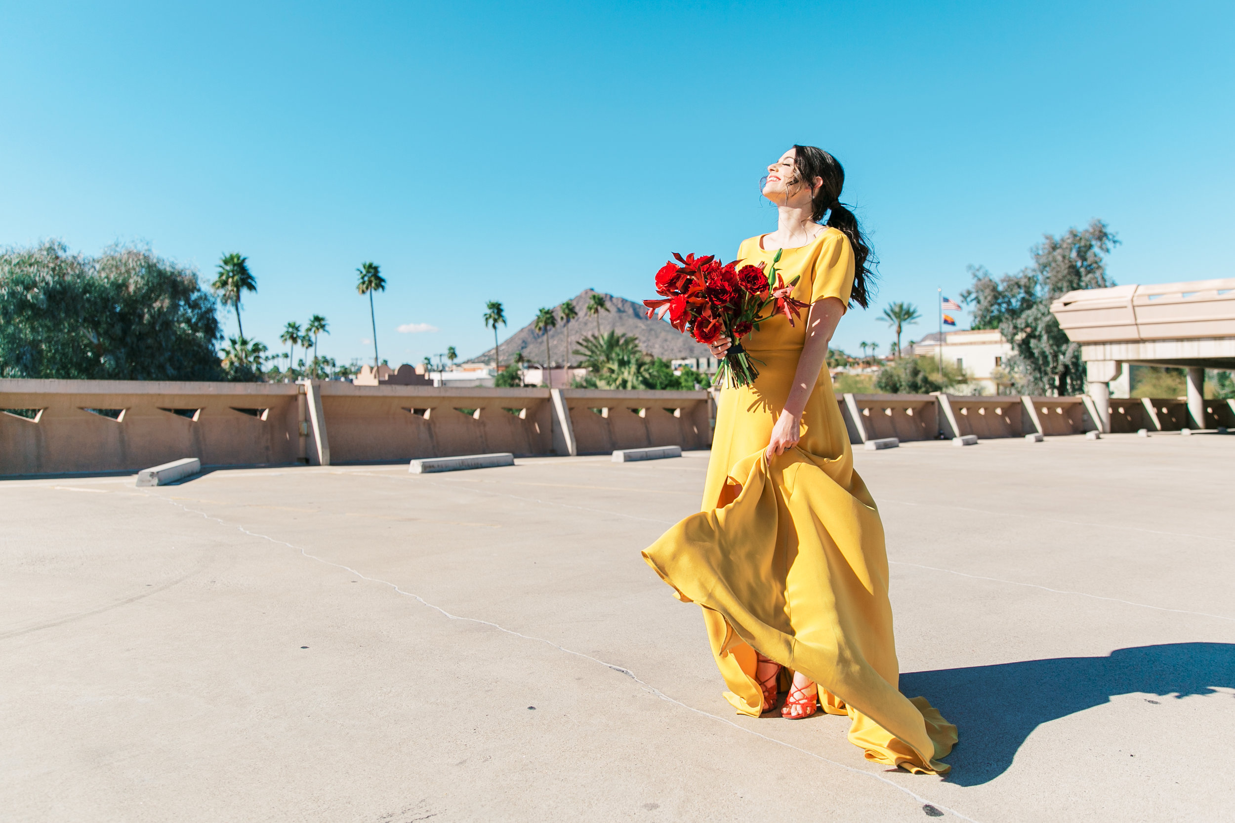 red and yellow wedding inspiration - red bouquet and yellow sarah seven gown