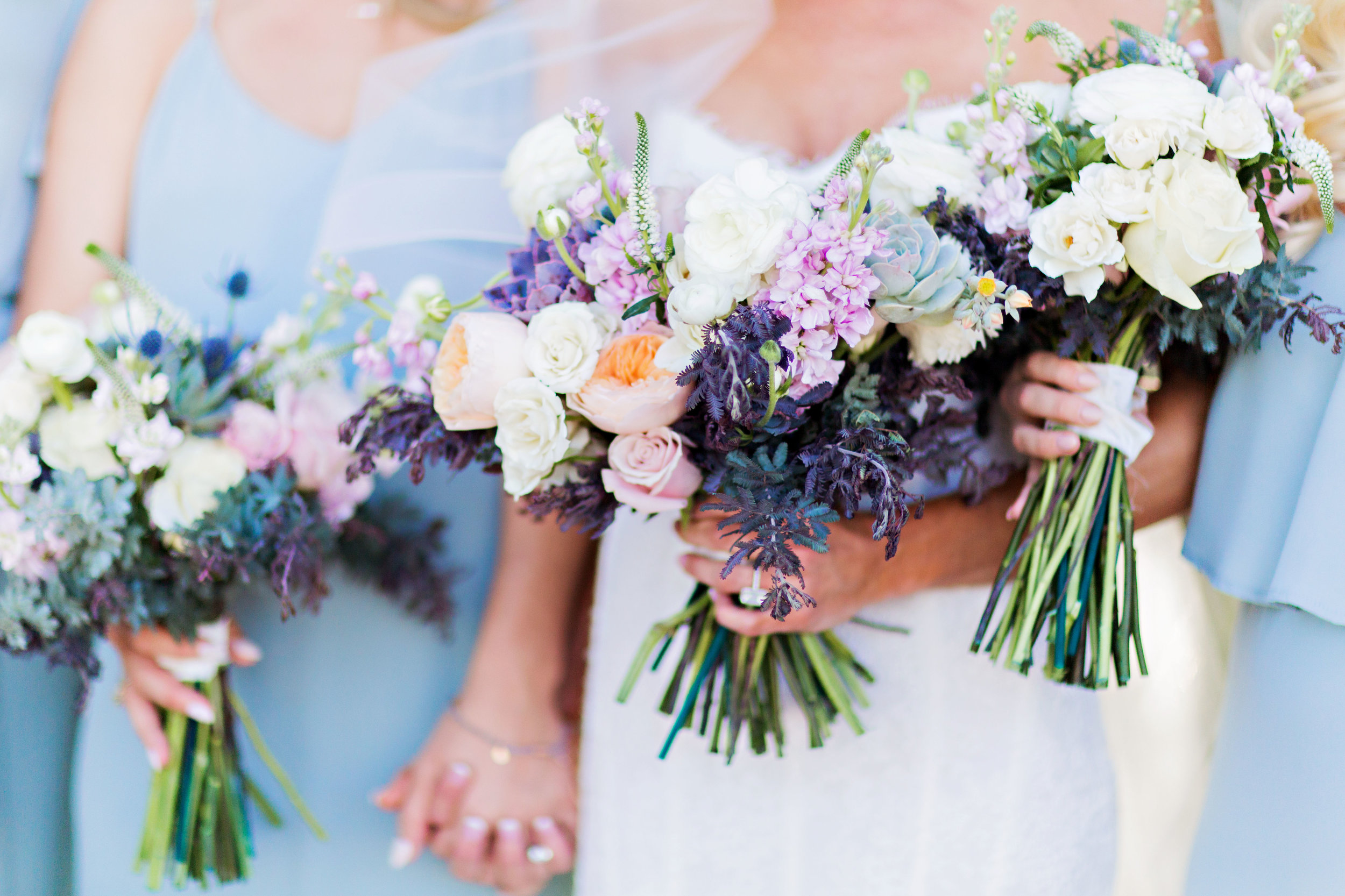 Classic blush, dusty blue, and lavender bridesmaids bouquets