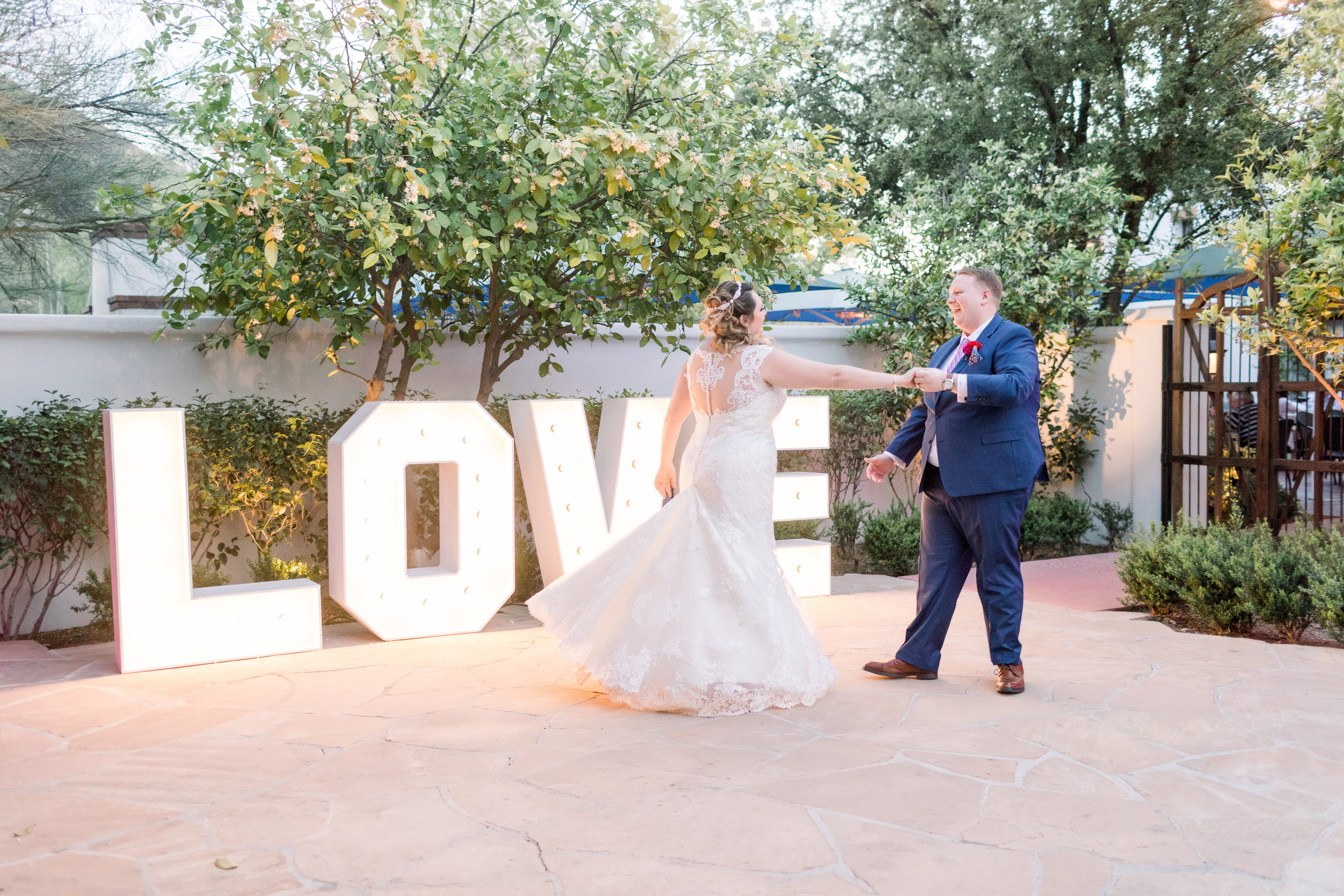 Roxanne and Brandon's El Chorro Wedding - Arizona florist Phoenix scottsdale Mesa chandler Sedona Prescott - First Dance with Marquee Love sign