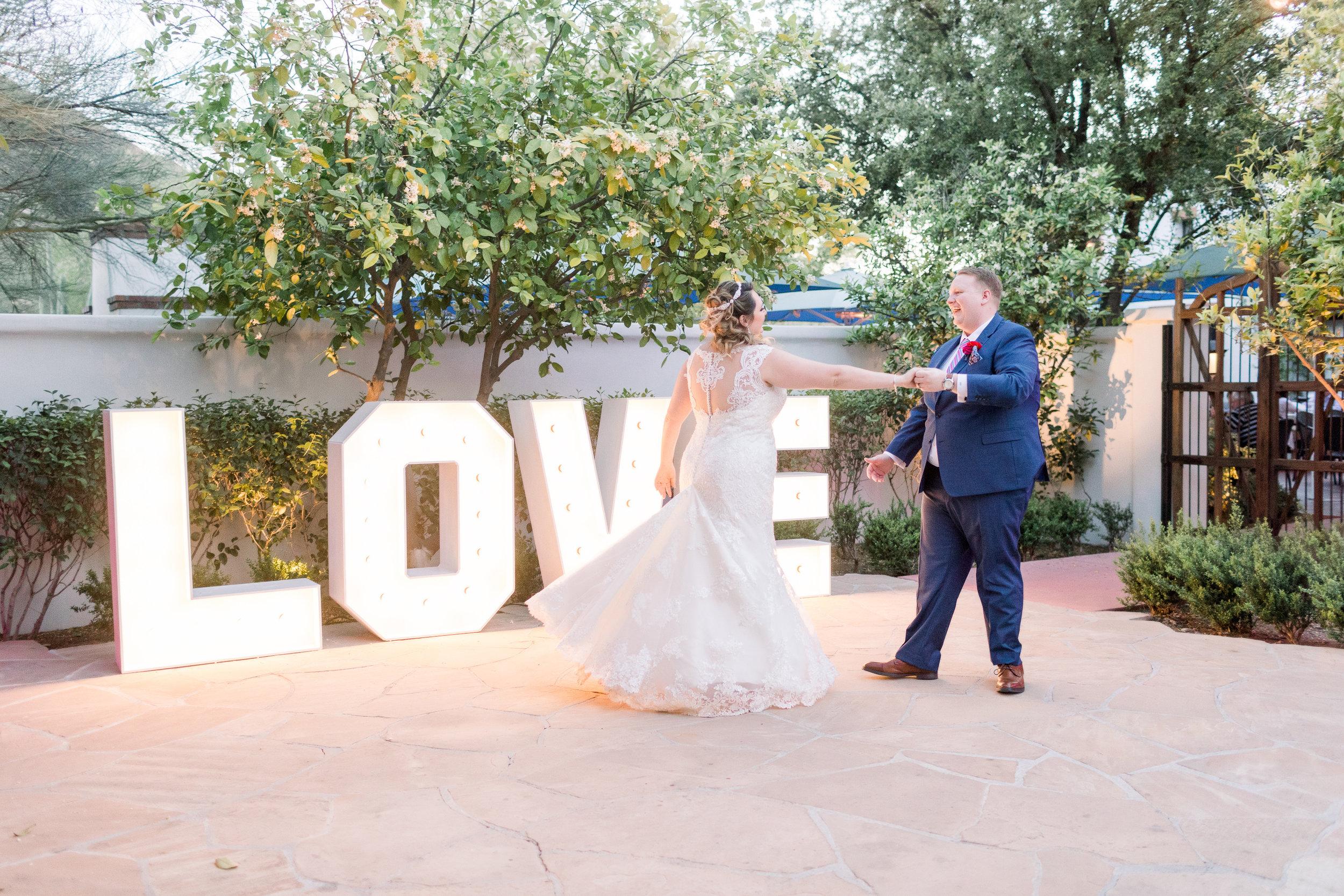 Roxanne and Brandon's El Chorro Wedding - Arizona florist Phoenix scottsdale Mesa chandler Sedona Prescott - First Dance with Marquee Love sign