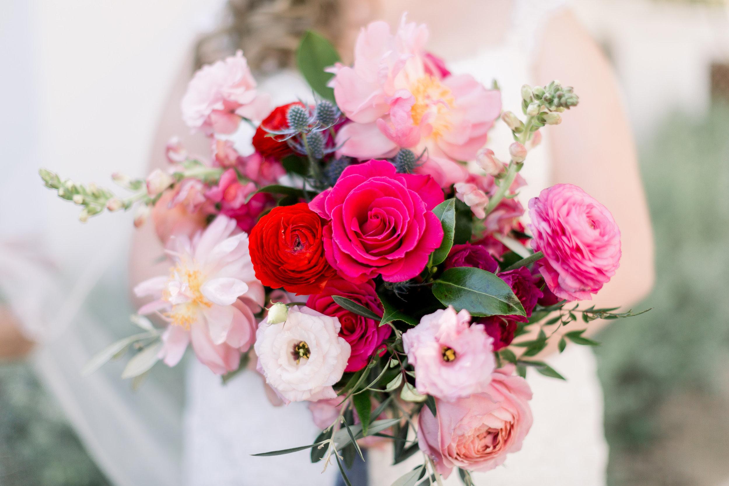 Roxanne and Brandon's El Chorro Wedding - Arizona florist Phoenix scottsdale Mesa chandler Sedona Prescott - Hot pink and red bridal bouquet with garden roses, peonies, roses, and snapdragon