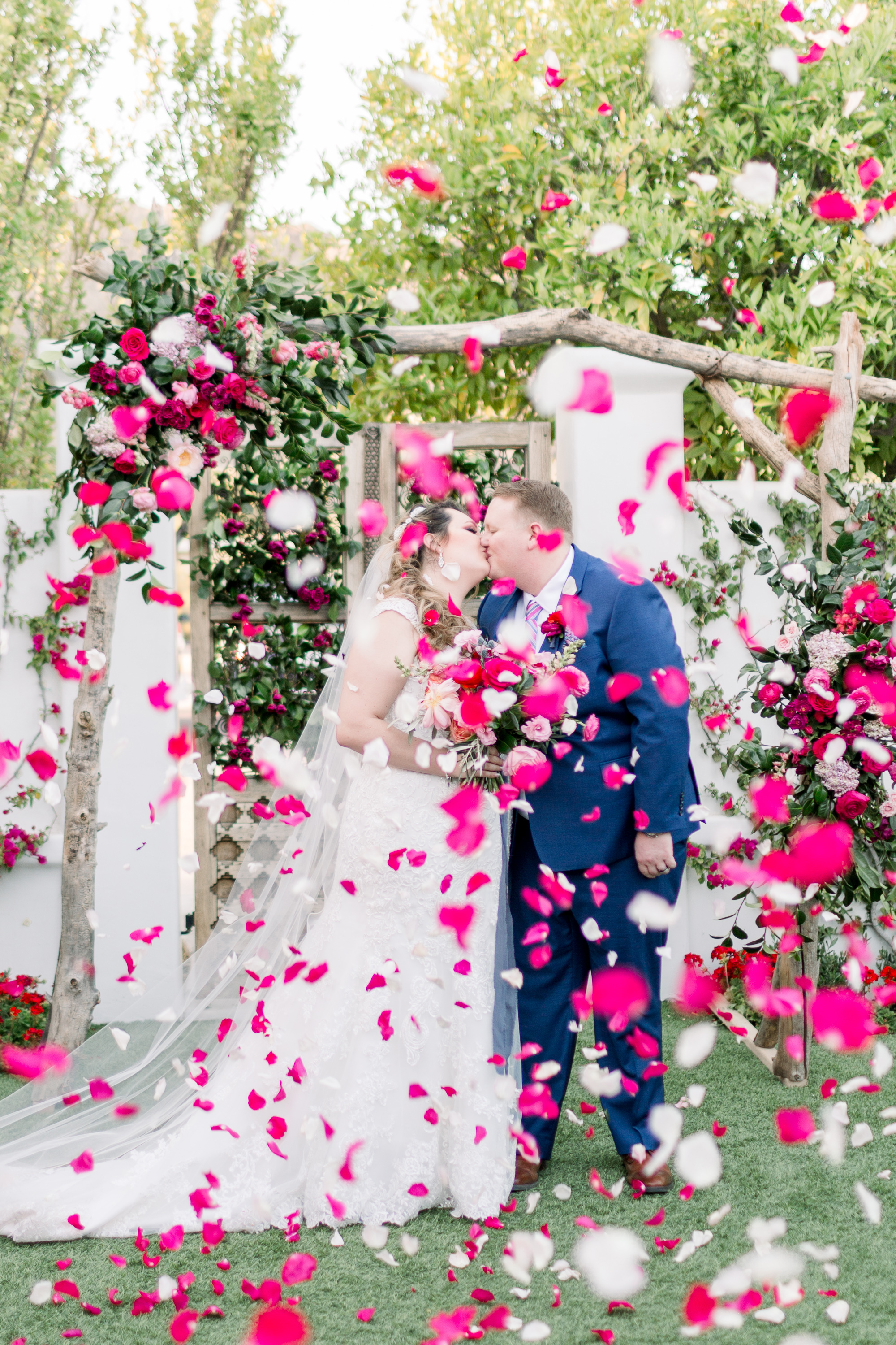 Roxanne and Brandon's El Chorro Wedding - Arizona florist Phoenix scottsdale Mesa chandler Sedona Prescott - Bride and Groom with Confetti Rose Petals