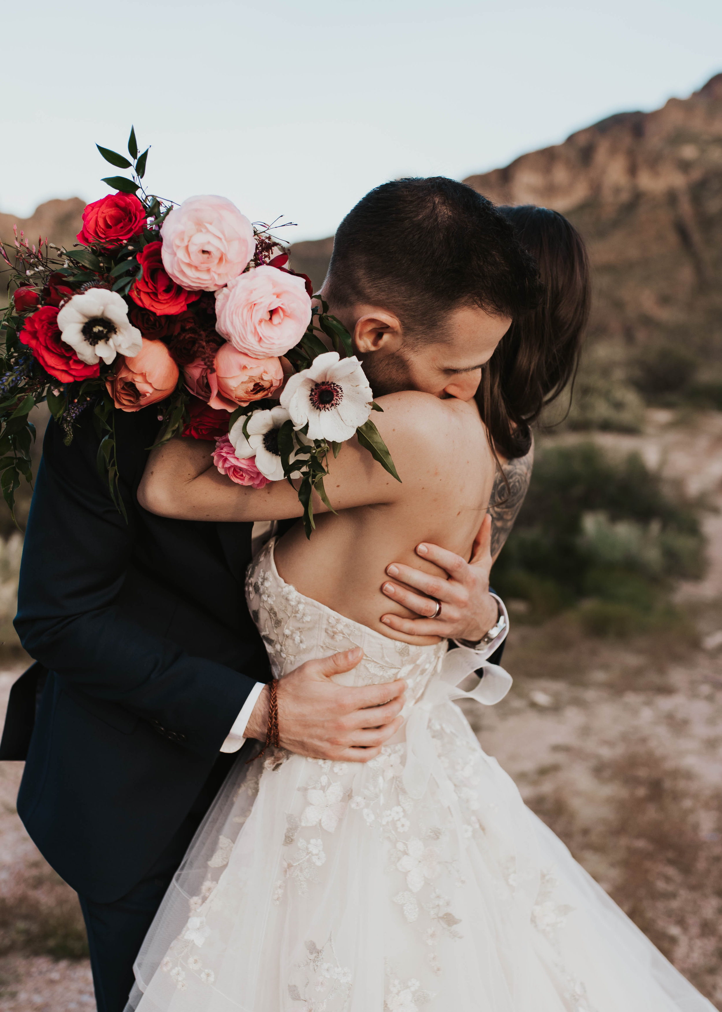 Desert Wedding at Tela Peralta - Arizona florist Phoenix scottsdale Mesa chandler Sedona Flagstaff Prescott - Couple Portraits - Bridal Bouquet with Anemone, ranunculus, garden roses, and hot lady roses.