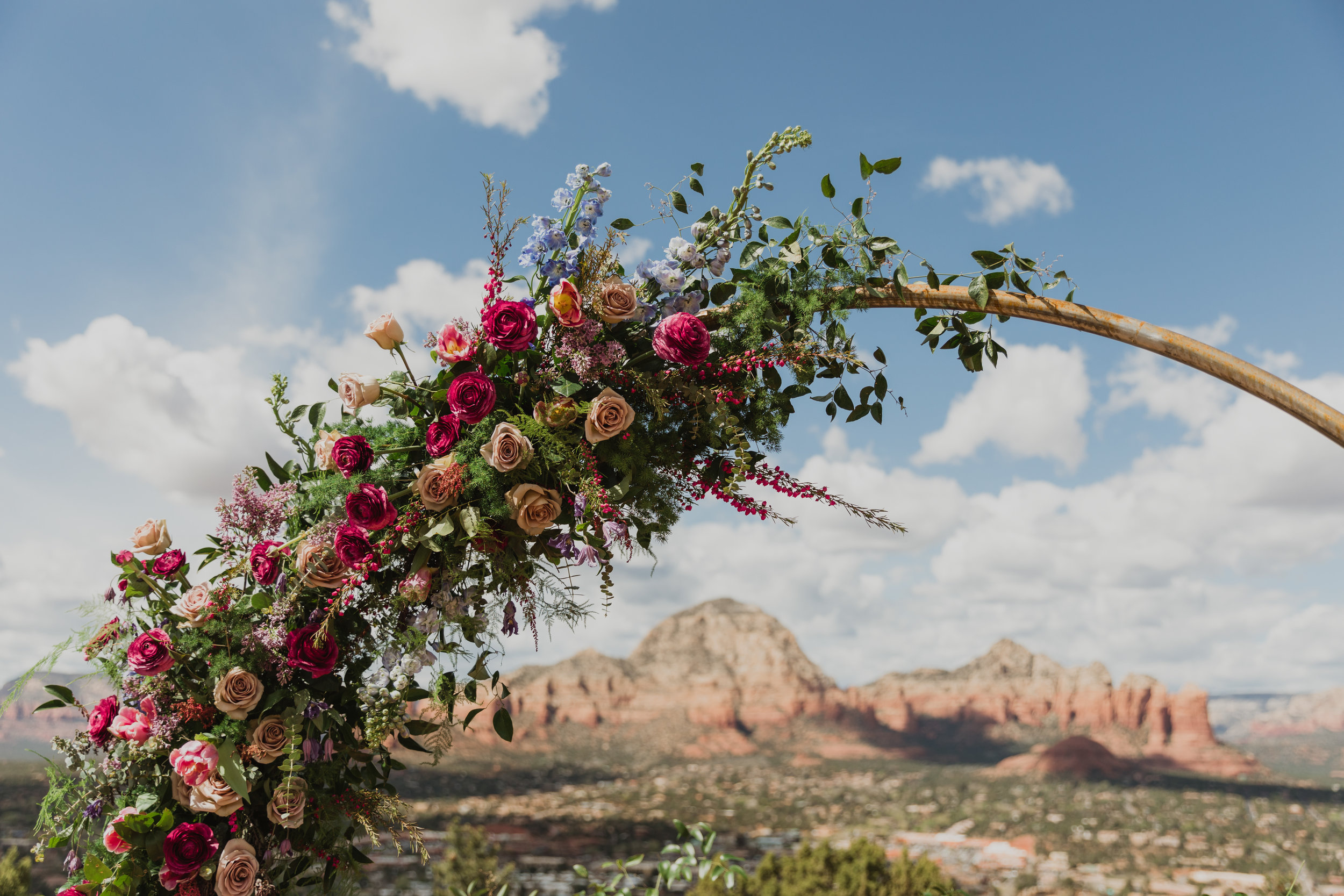 Stars and Moon Inspired Wedding in the Red Rocks of Sedona - Arizona Florist serving Phoenix scottsdale Mesa chandler Flagstaff Prescott - Purple, Blue, and Greenery Circle Arch Inspiration