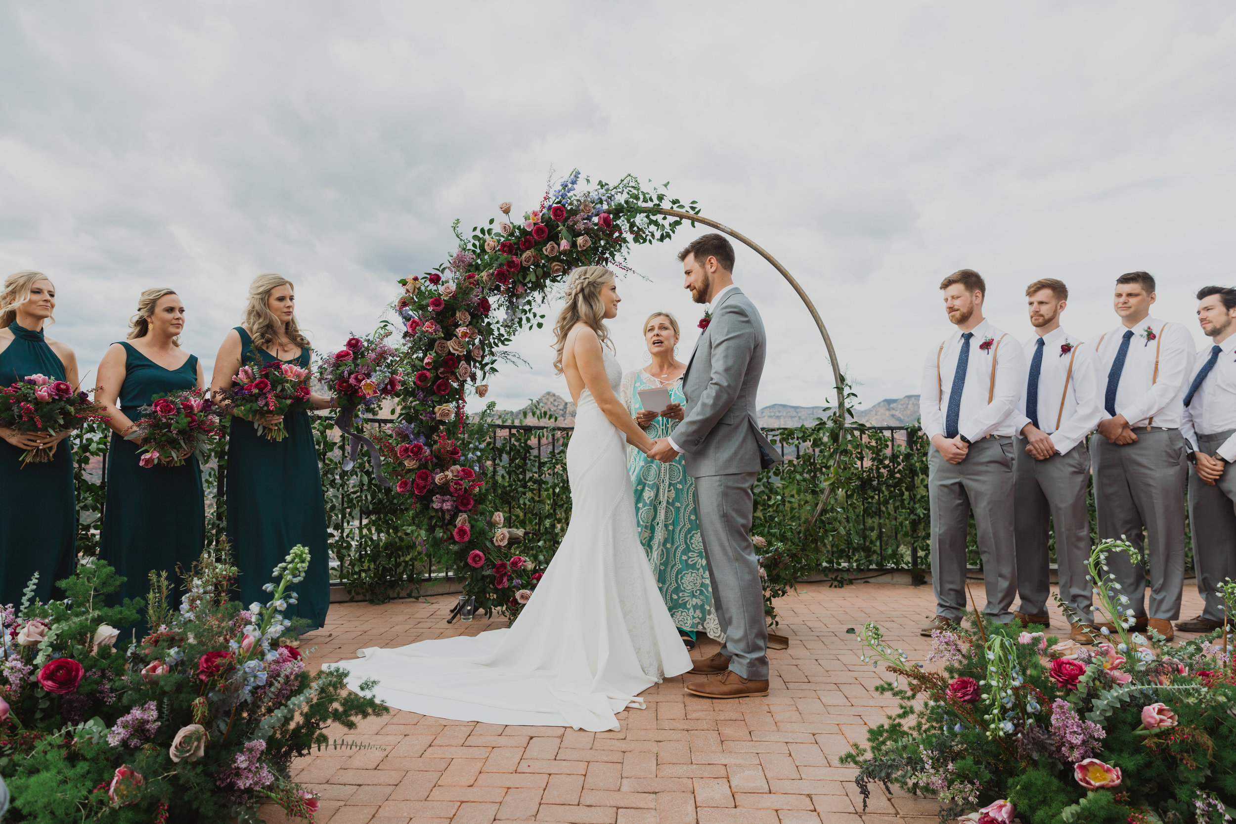 Stars and Moon Inspired Wedding in the Red Rocks of Sedona - Arizona Florist serving Phoenix scottsdale Mesa chandler Flagstaff Prescott - Purple and Blue ceremony inspiration with circle arch