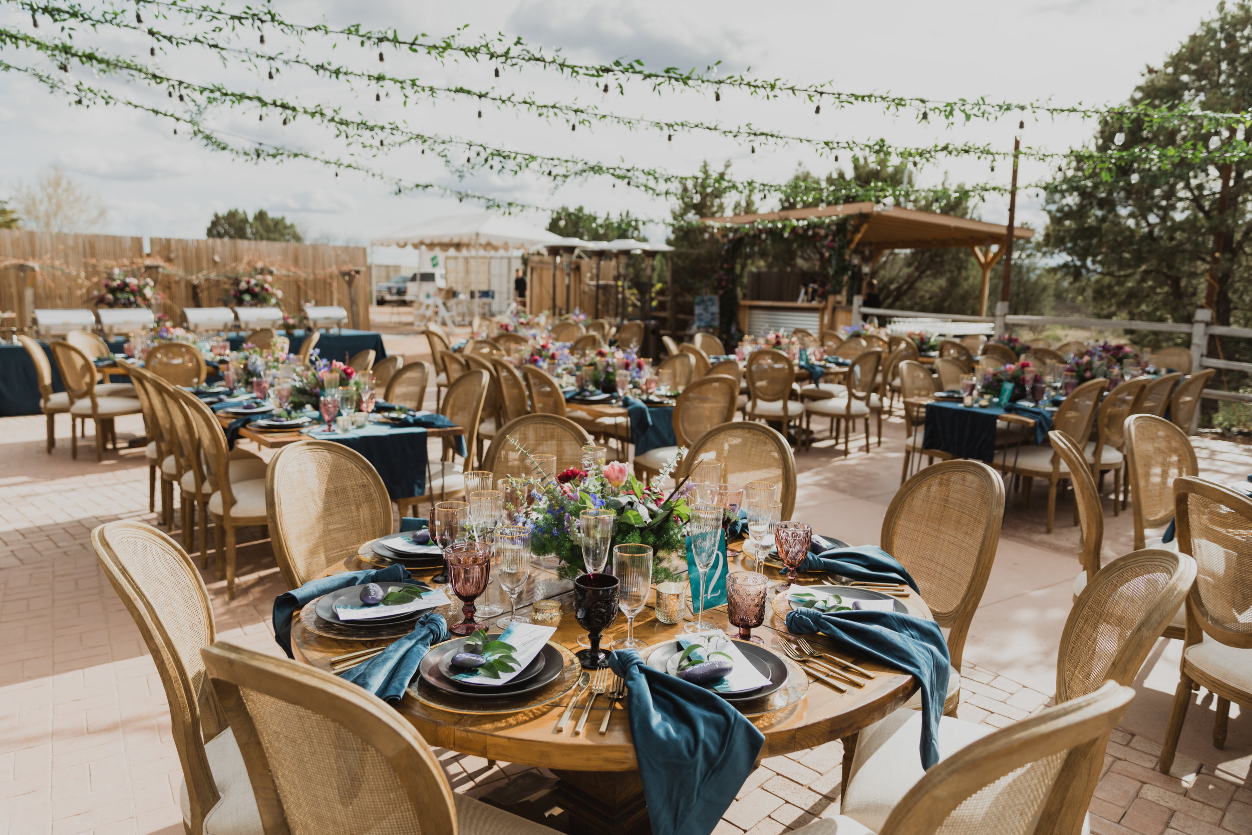 Stars and Moon Inspired Wedding in the Red Rocks of Sedona - Arizona Florist serving Phoenix scottsdale Mesa chandler Flagstaff Prescott - Open Air Wedding Reception with Round and Rectangular Tables