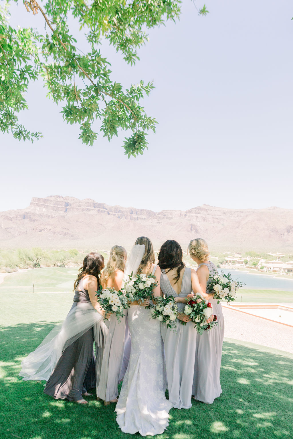 Superstition Mountain Destination Wedding - Arizona Wedding Florist - Phoenix, Scottsdale, Sedona - Bridesmaid Style Inspiration - Mixed Grey Gowns - All white bridesmaids' bouquets