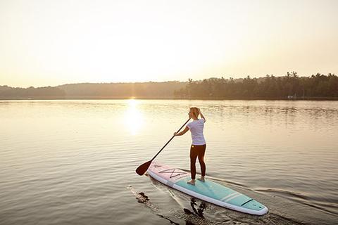 female-paddling-into-sunset_large.jpg