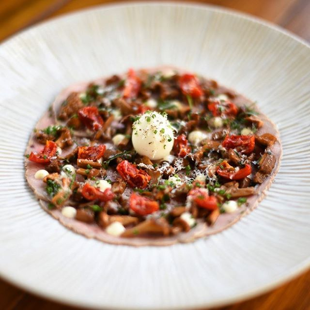 Our veal carpaccio.......wild mushrooms, truffle pecorino mayo, dried cherry tomatoes, soft quail egg and olive oil. #trufflepecorino #girolles #quaileggs #carpaccio #autumnfood #events #eventdesign #eventplanner