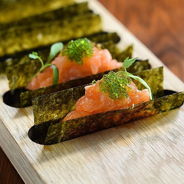 Spicy miso salmon nori taco with wasabi tobiko and coriander........these simple delicious canapés are inspired by working with the amazing Taiji Maruyama @beaverbrook......super healthy and so yummy. Photography by the awesome @thegaztronome #event #events #canapé #taco #nori #lochduart #scottishsalmon