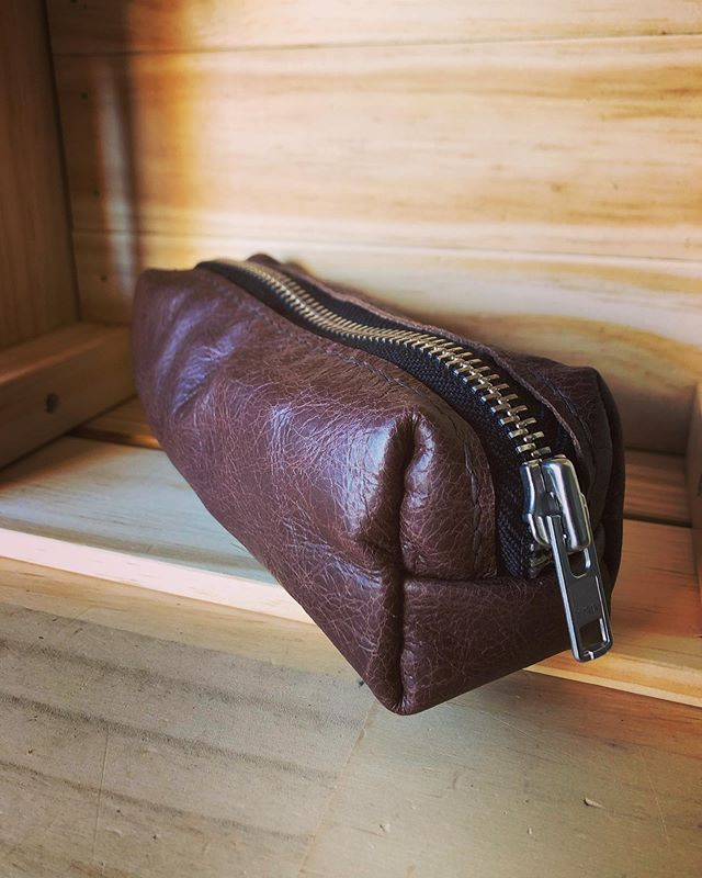 One of our hand-stitched leather pencil cases with the new black zippers. • • • • #leather #leathercraft #handmade #artisan #artist #sketching #pencilcase #travel #adventure #writing