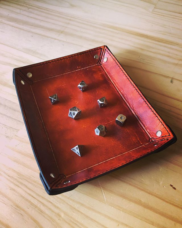 We're working on a new line of tabletop gaming accessories, starting with these hand-stitched leather dice trays. We've got a bunch more designs and products planned, so stay tuned! • • • • #leather #leathercraft #dice #tabletop #tabletopgames #dnd #dungeonsanddragons #ttrpg #rpg #handmade #artisan #gaming #dicetray