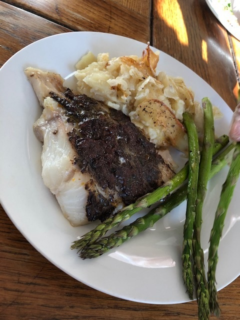 Roasted fish with sun-dried tomato and black olive tapenade, potato gratin and grilled asparagus
