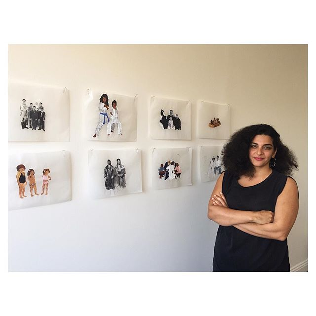 "From our interview today with the incredible Susu Attar @susuhantusu, who is pictured here with selections from her ""Tracing the Arab World,"" a series of family photos submitted by strangers and remembered through painting ✨  Stay tuned!"