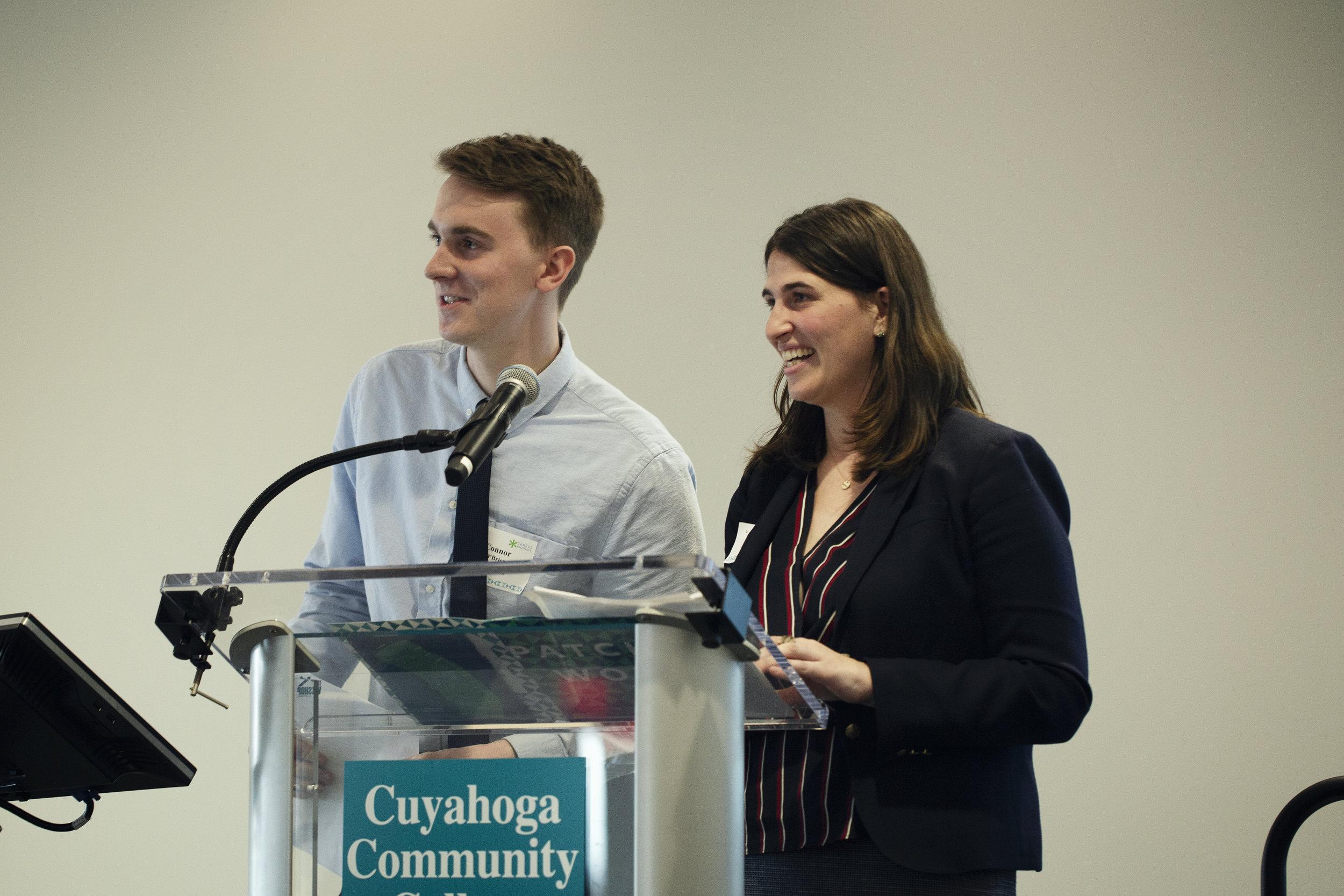 Rachel Oscar and Connor O'Brien presenting the Volunteer Award