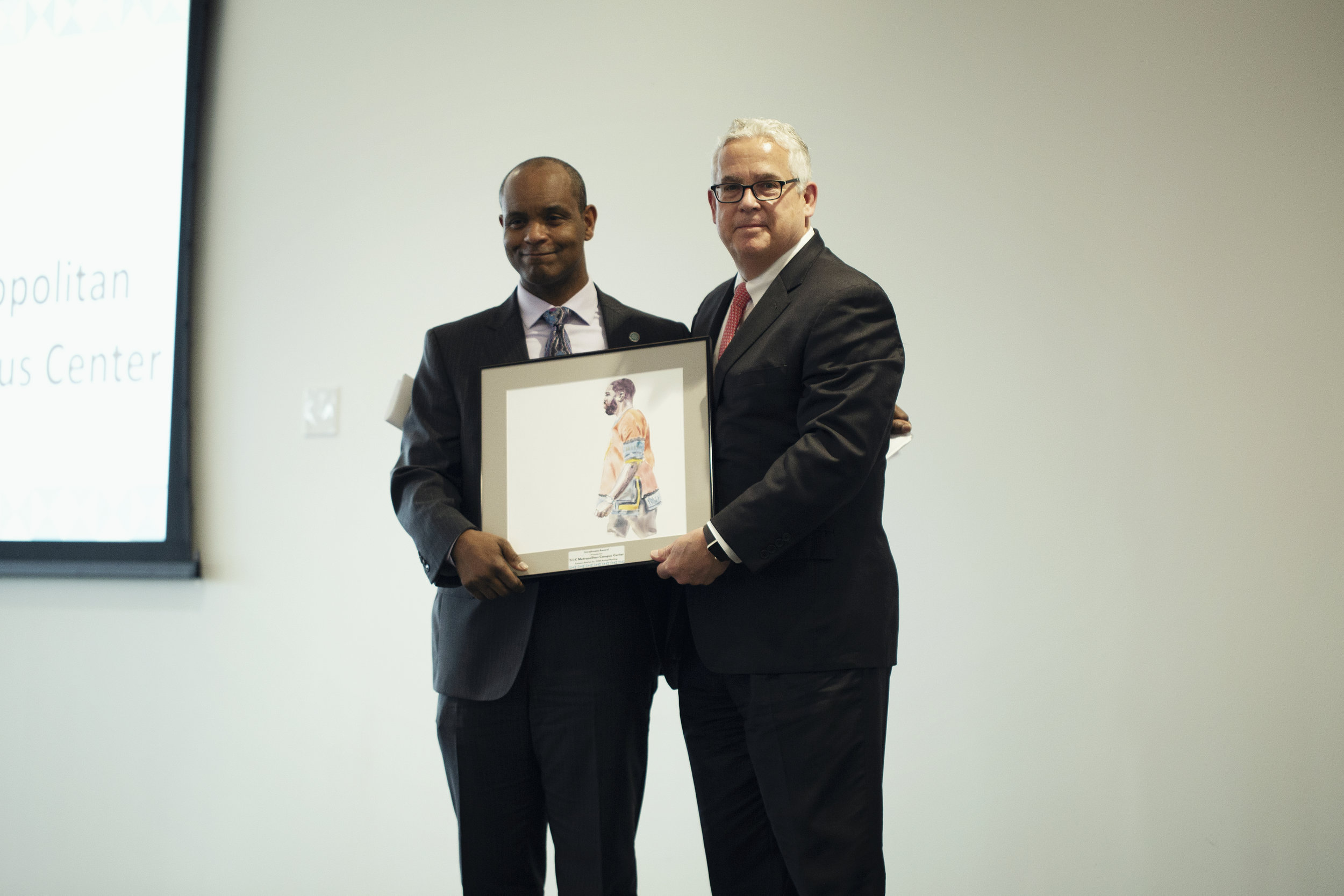 Dr. Michael Schoop, President of Tri-C's Metro Campus, accepting the Investment Award.