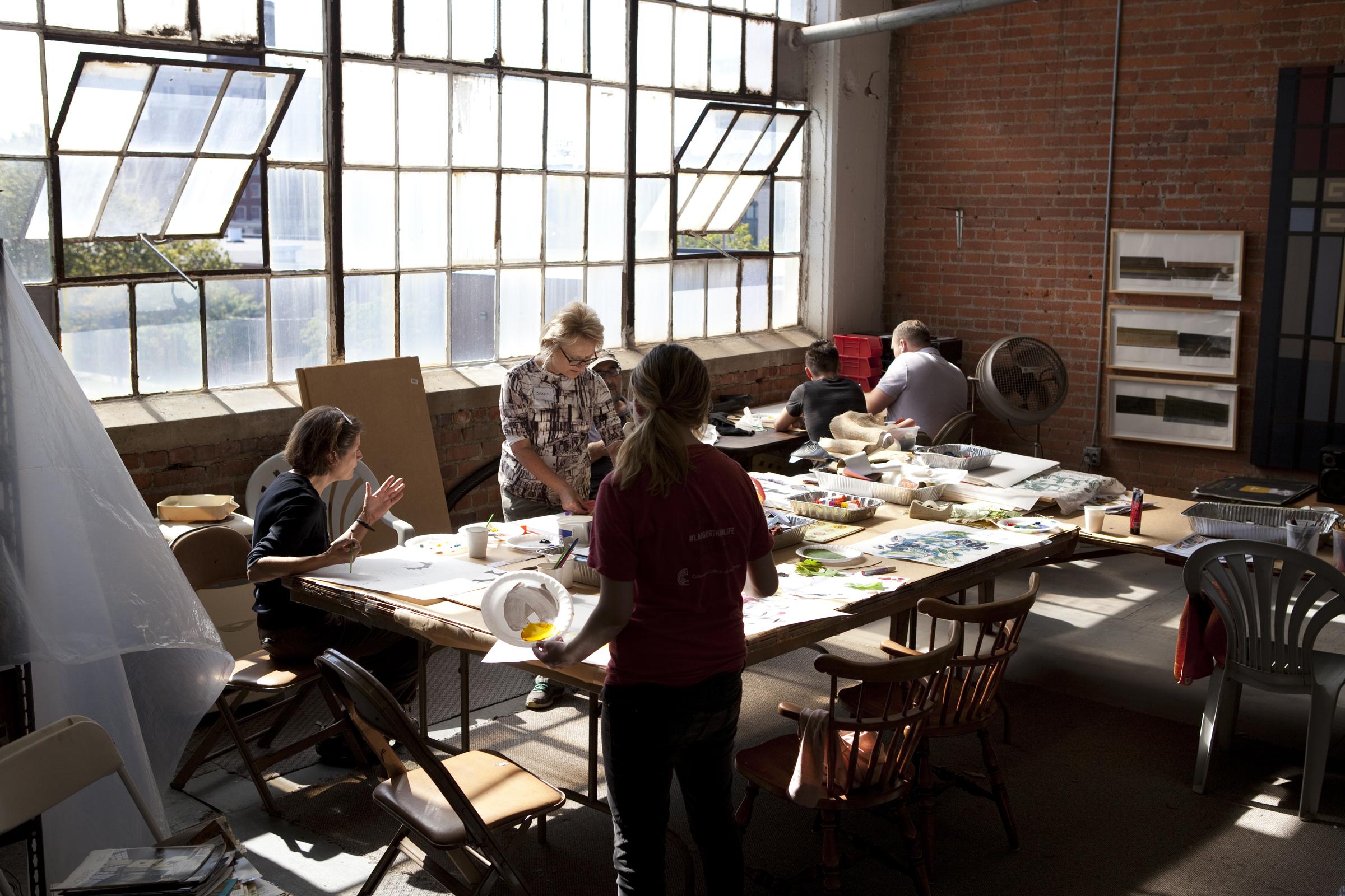 Superior Ave. banner design sessions in Bill's studio