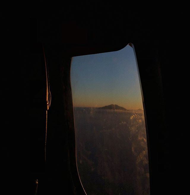 Flying with lion air at sunset includes great view through smudgy window. #latepost