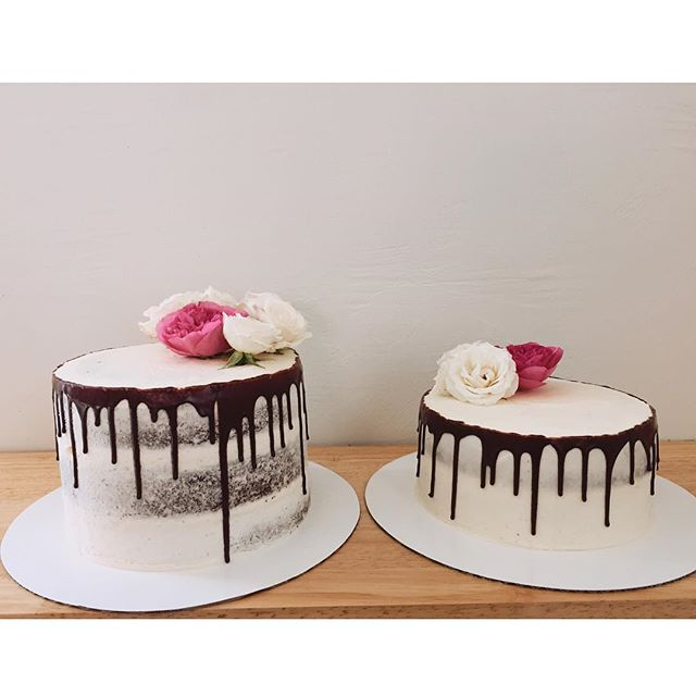 We have two extra naked Katie's chocolate cakes in the store today. We have a two tier 8 inch that is $42 and a 3 tier 8 inch that is $50. They both have fresh blooms on top.  You can private message us or stop in store to purchase. #katiebugscakes
