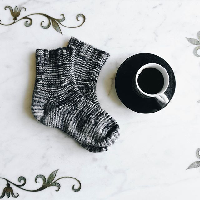 These socks have been my go-to all season (and have shown up pretty often on my feed). I was totally prepared to have put them away in favor of my warm-weather wardrobe pieces by now, but the forecast says DC is going to be all about rain next week - good thing these are my favorite socks to wear with rain boots!⠀ .⠀ .⠀ .⠀ #knitting_inspiration #knittinginspiration #knitting #knit #knitsagram #knittersofig #knittersofinstagram #knittersoftheworld #knitwear #instaknit #instaknitters #instaknitting #nevernotknitting #knitters #handknit #knittingaddict #thehooknookers #ourmakerlife⁣ #yarnpunk #yarn⁣ #ravelry #knitweardesign⁣ #knitsocks #handmadesocks #coffee #vintagemug⠀