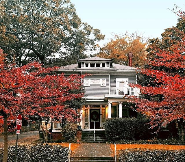 Today was a nice crisp fall day here in Atlanta (finally!). A friend of ours snapped this picture in Midtown while out and about so we just had to share it with you. Check out those poppin' red leaves that beautifully frame the house in the background! While those leaves really steal the show, the house has some great details as well, including a nicely corbelled chimney, Ionic capitals on the porch columns, and a lovely door surround with some nice large sidelights and panels below. Let's hope the fall weather continues and we don't crank the heat back up anytime soon…  Photograph by @jburnsgt