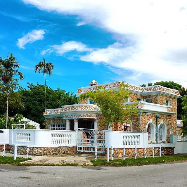 "We stumbled upon this house during our last trip to Miami, and what a truly Miami house it is! One of my favorite architectural features that you come across in that area is the use of ""coral rock"" (which is actually oolitic limestone), to build some of the more distinctive buildings. These types of homes are very common in Coral Gables, the most notable of which is probably the Merrick House, but they can be found all over the city and it is always exciting when you come across one. This house is a particularly ornate example (maybe even a little gaudy), with the gold scroll work in the curving frieze, and the matching decorations of its Corinthian-esque columns.  Photograph by Derek Anderson"