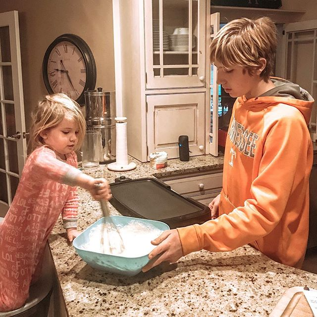 """When your toddler and teenager are on pancake duty together and you hear your teenager say, """"Oh, did you fall off the stool? Well don't just sit there and cry. Come on, get back up and stir these if you want to."""" 🤣 Wonder who he sounds like. 🤔😂 #likemotherlikeson"""