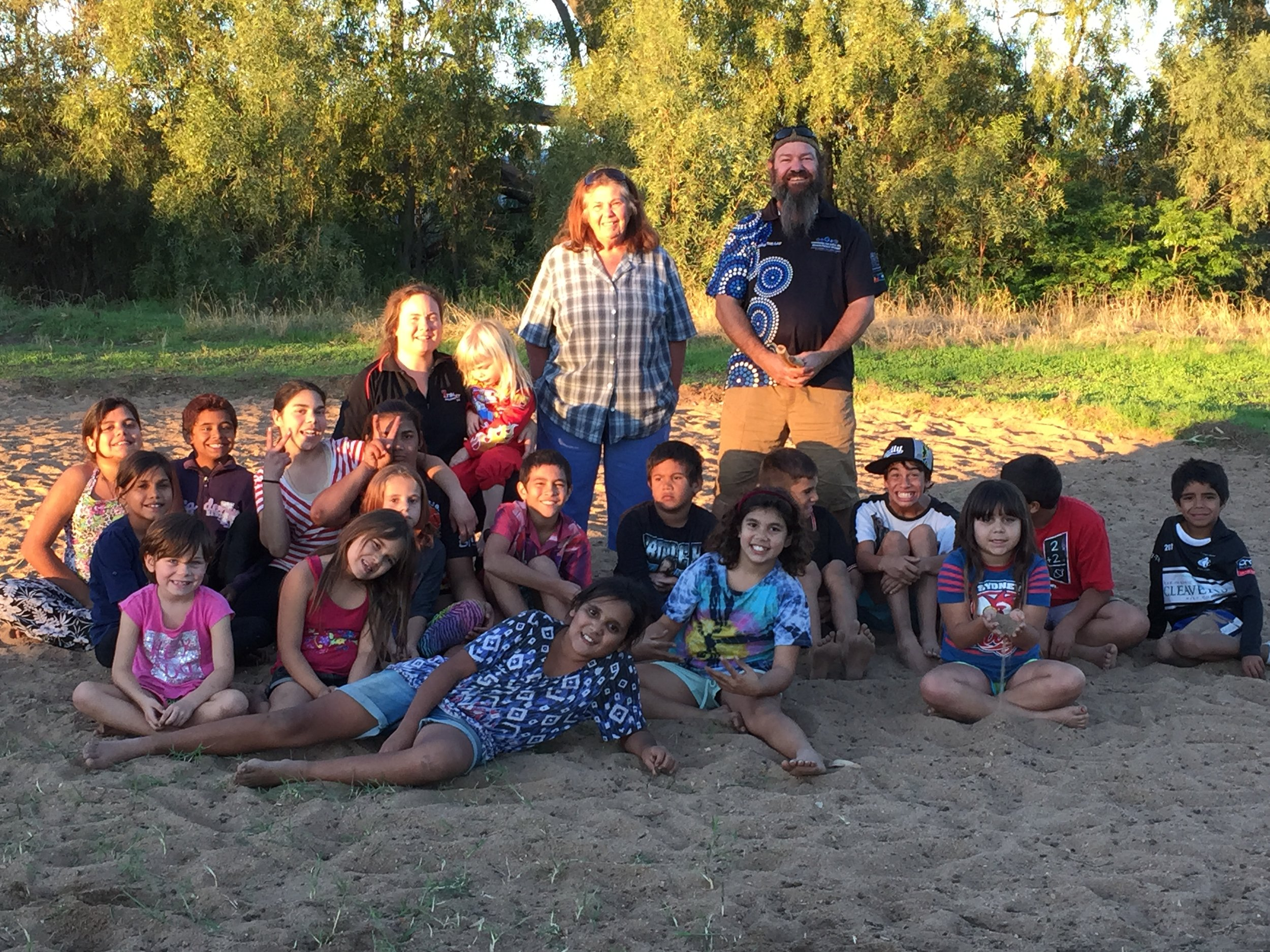 Milan Dhiiyaan with local Coonamble Elder and children participating in a local Corroborree (ceremony and dance).