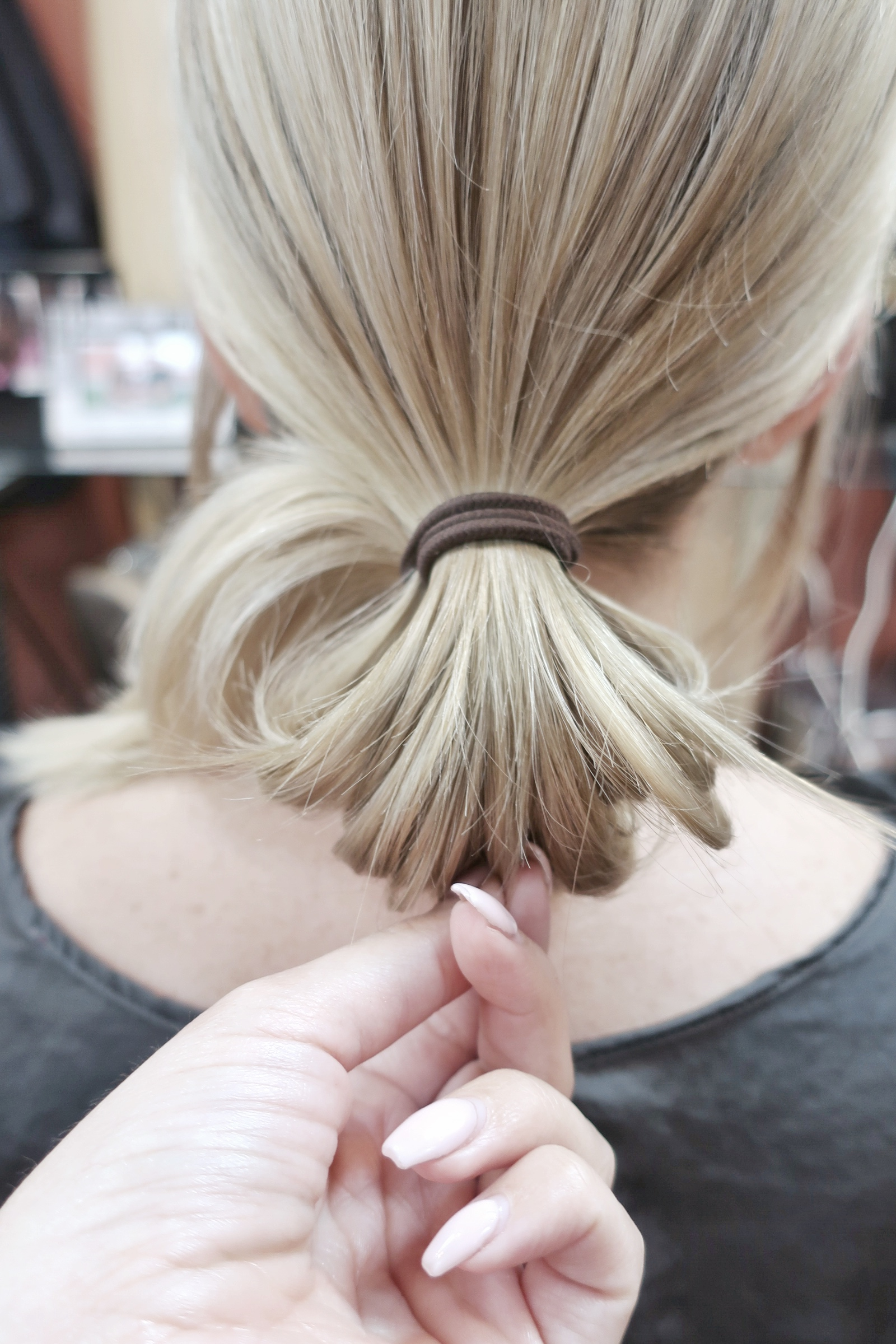 "pinch and pull pieces to give a more ""lived in"" textured low bun"