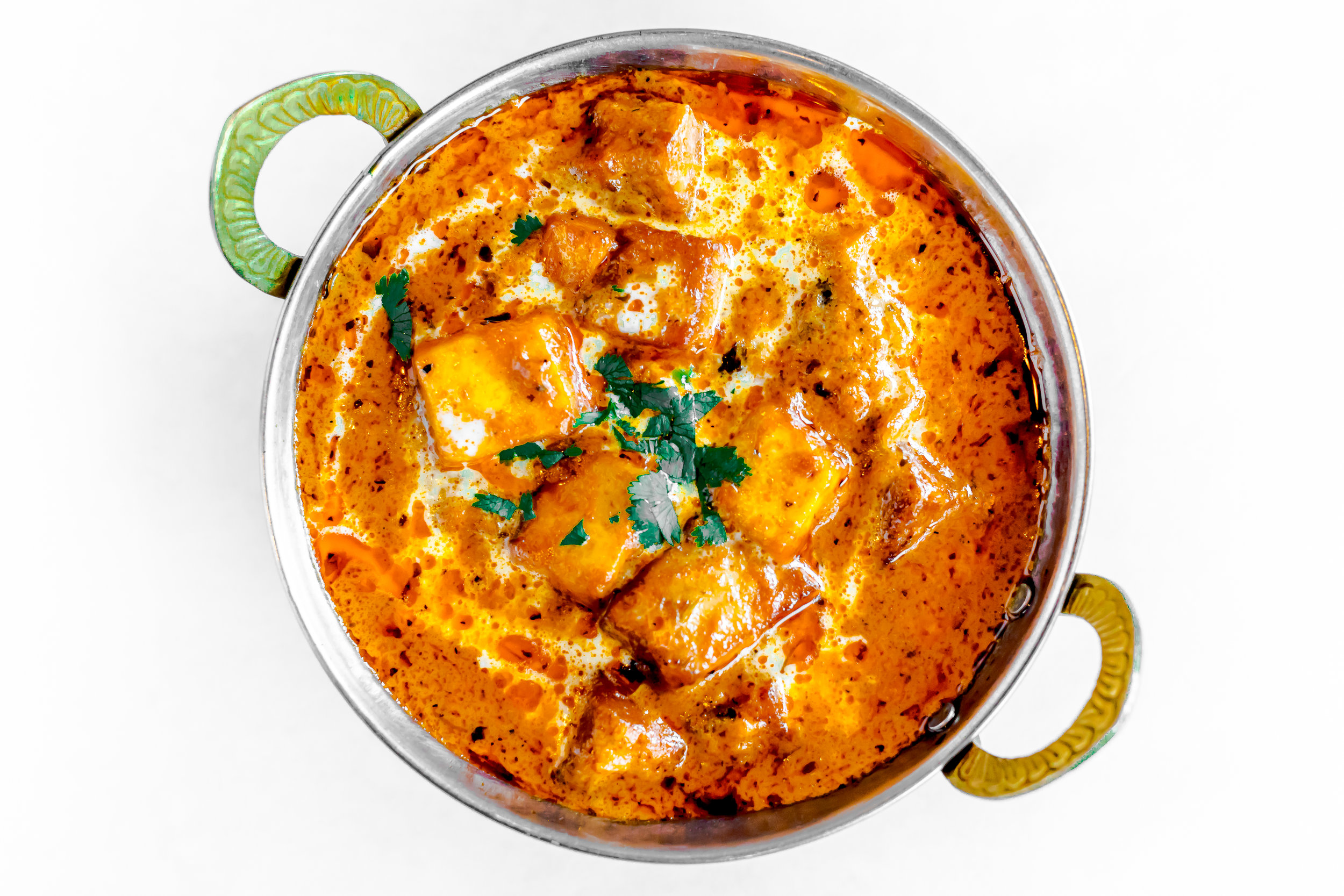 Paneer mASALA - Tender Piece of cheese marinated with delicate spices and roasted in tandoor and served with Mint and tamarind chutneys. $14