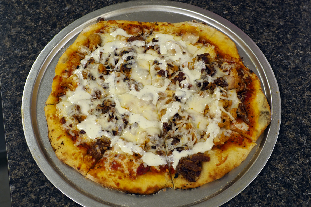 Chicken, Bacon & Ranch Pizza - Chicken, Caramelized Onions, Bacon, Ranch Dressing, and Fresh Shredded Mozzarella Cheese$12