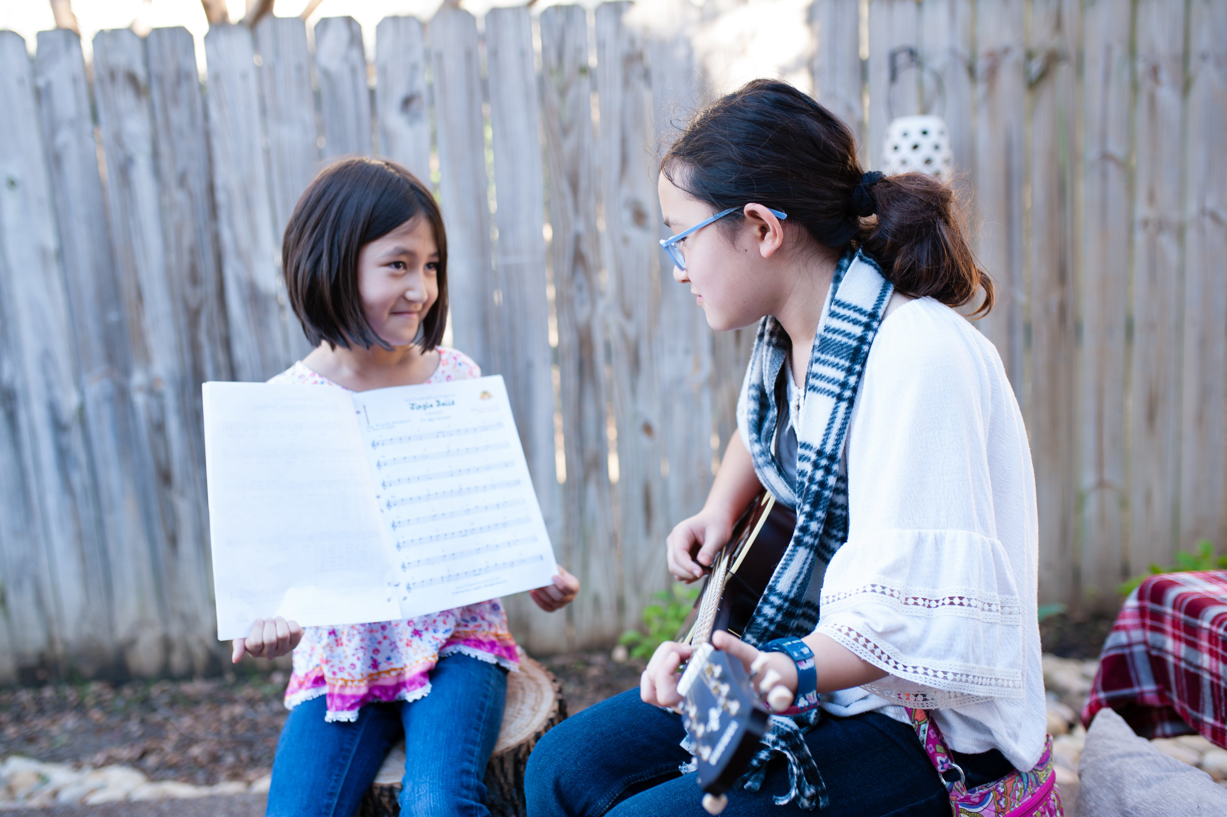 Props such as a guitar can help clients feel more comfortable and at ease.