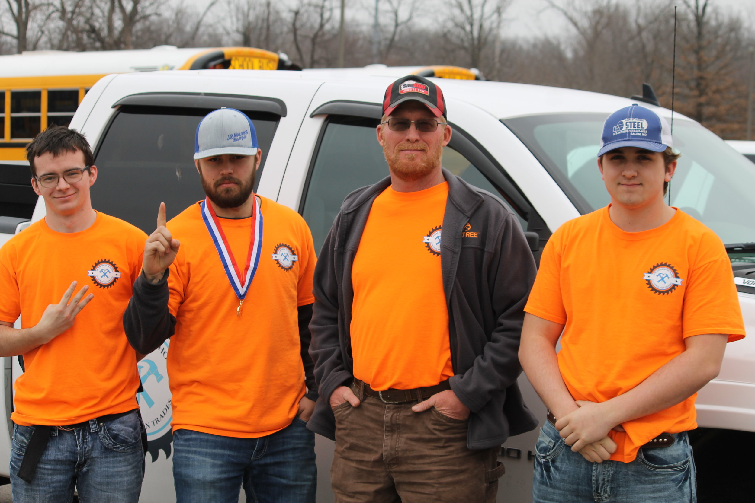 Jay Busbey (far left), a senior in the program, placed third in the written contest. Dell Hoffmeister (second from left), a junior in the program, placed first in the skills contest.