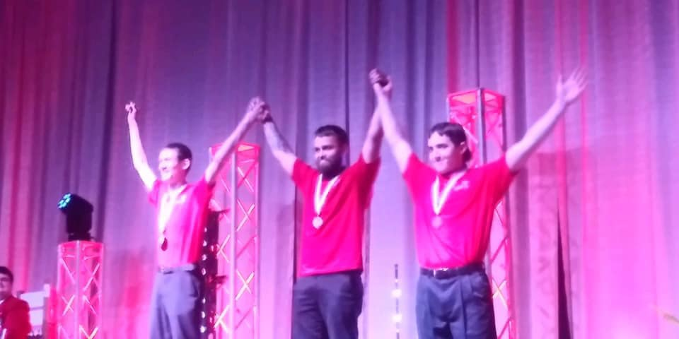 Dell Hoffmeister (Center) wins the State Championship in SkillsUSA Carpentry Contest.