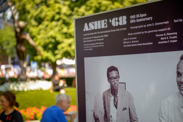 The Ashe '68 Phpto Exhibit, 16 panels, displayed on The Alley, the main walkway at the US Open. In the background, left, the iconic Arthur Ashe statue.